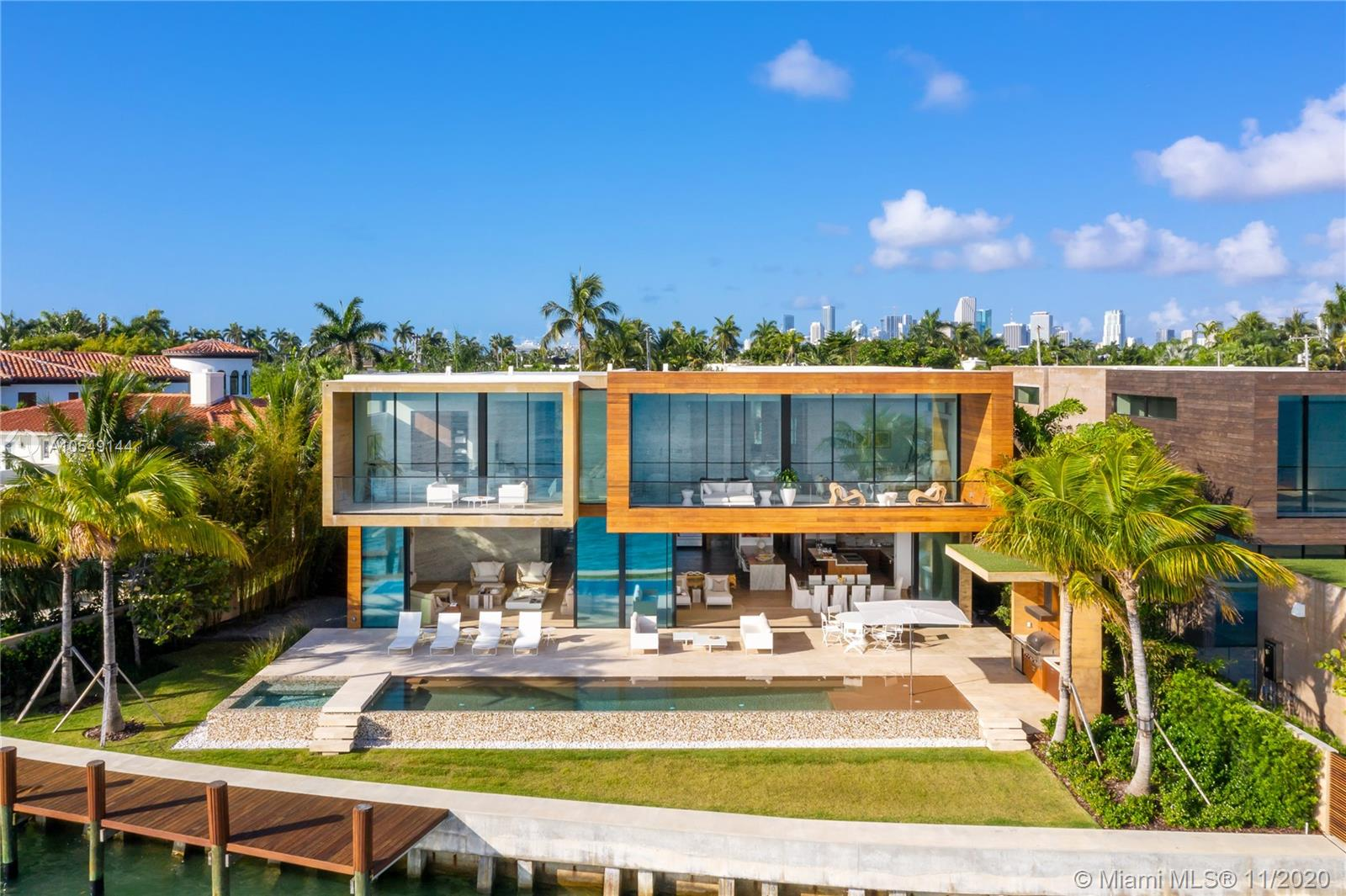 ULTRA MODERN NEW WATERFRONT ARCHITECTURAL MASTERPIECE DESIGNED BY CHOEFF LEVY FISCHMAN ARCHITECTURE & FURNISHED BY ARTEFACTO ON THE VENETIAN ISLANDS! This Wide Bay Tropical Modern Villa is Built with Post Tension Slab Construction & 12' Vitrocsa Glass Invisible Wall Systems. A Rare Find- Newly Built under previous City of Miami Beach Codes to allow for higher ceilings & unique layout w Master Bedroom & Bath + 2 Guest Suites on Water. Family Villa w 7 Beds, 7.5 Baths + Maid's in 8,048 Adj Gross Sq Ft of Living Space on 14,224 Sq Ft Lot w 107' of Waterfront. Double-Sided Infinity Pool w Spa & Rainwater Re-harvesting system; Ipe Wood Dock + New Seawall; Board-Formed Exposed Concrete Structure; Brazilian Cumaru Wood Finishes & White Oak Flooring Thruout; Lutron Home Automation; 80kW Generator.