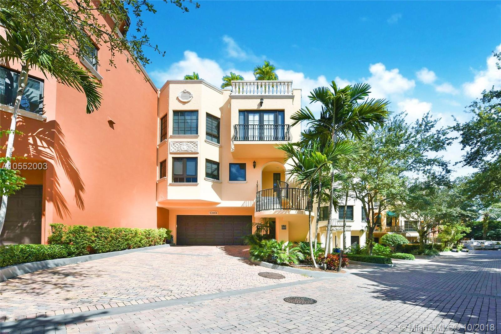 """Mediterranean-style 4-level villa overlooking Peacock Park & Biscayne Bay in the exclusive gated enclave """"Cloisters on the Bay"""" in Center Coconut Grove, just steps from shopping, restaurants, parks & marinas. This home features a private elevator, hurricane-impact windows, travertine flooring & 2-car attached garage. Main Level offers family room, ample storage & covered patio. 2nd Level boasts eat-in kitchen w/professional gas range & walk-in pantry, dining room, powder room, office, great room w/custom bar & terrace. 3rd Level offers 3 bedrooms w/ensuite bathrooms & laundry room. 4th Level offers expansive rooftop terrace w/hot tub & covered dining boasting bay, park & skyline views. Private amenities include club house, tennis court, pool & bay access for watersports. NOT IN FLOOD ZONE."""