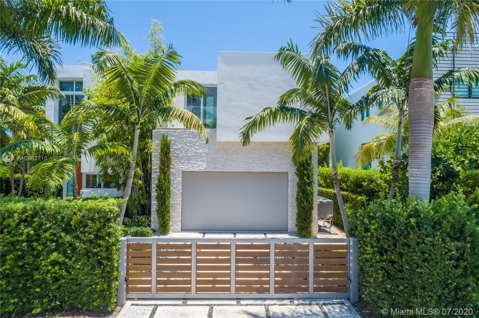 Lushly landscaped and strikingly modern two-level turnkey residence located in Hibiscus Island on a prime 9,500 sf corner lot. Combining functionality and design, it has an adj. area of 4.090 sf., 5 beds and 5.5 baths with glass walls that overlook the resort-inspired backyard. This tropical oasis features an inviting pool, fire pit, grill and lounging areas. Upstairs is the clean-lined master bedroom with 2 walk-in closets and spa-like bath, two guest bedrooms and a bedroom converted into a fitness room. Highlights include an open kitchen with upright wine cooler, office, two-car garage, rooftop terrace and more.