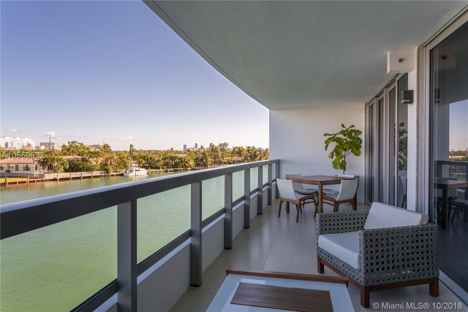 Beautiful turn-key unit in highly desired Bay Harbor Islands. Direct east water views for this large 1 bedroom + den unit. Completely furnished and equipped by renowned designer. High-end finishes throughout with modern furniture, stainless steel appliances, washer and dryer inside the unit. Walk-in closets and comes with a storage unit located across from front door. Beautiful rooftop pool. Walking distance coveted Ruth K. Broad elementary school and very close to Bal Harbour shops, restaurants, cafes and beach.