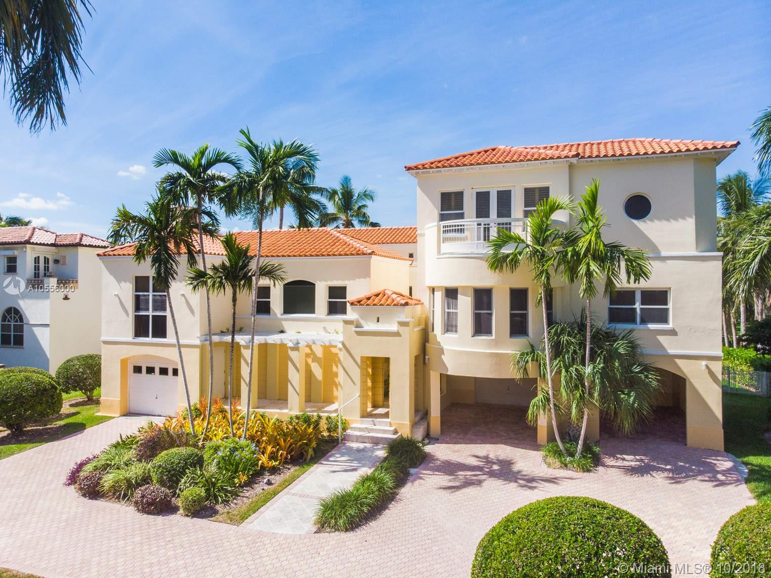 On prestigious Mar Street in gated Gables by the Sea you will find this 5/5/1 contemporary masterpiece w/110' of seawall + no bridges to Biscayne Bay! Davits, boat lift + floating dock are a boater's dream come true! The 2nd floor living spaces are generous + architecturally interesting. The large eat-in kitchen provides beautiful views to the pool + wide canal. Sit on the back patio + enjoy Miami's beautiful sunsets. The spectacular, private master suite on the 3rd level includes generous his/her walk-in closets, sitting area + luxurious master bathroom. On the ground level you will find 2 garages + a completely enclosed basement. This is a very special home which will allow you to enjoy all that Miami coastal living has to offer! Excellent public + private schools, neighborhood park.