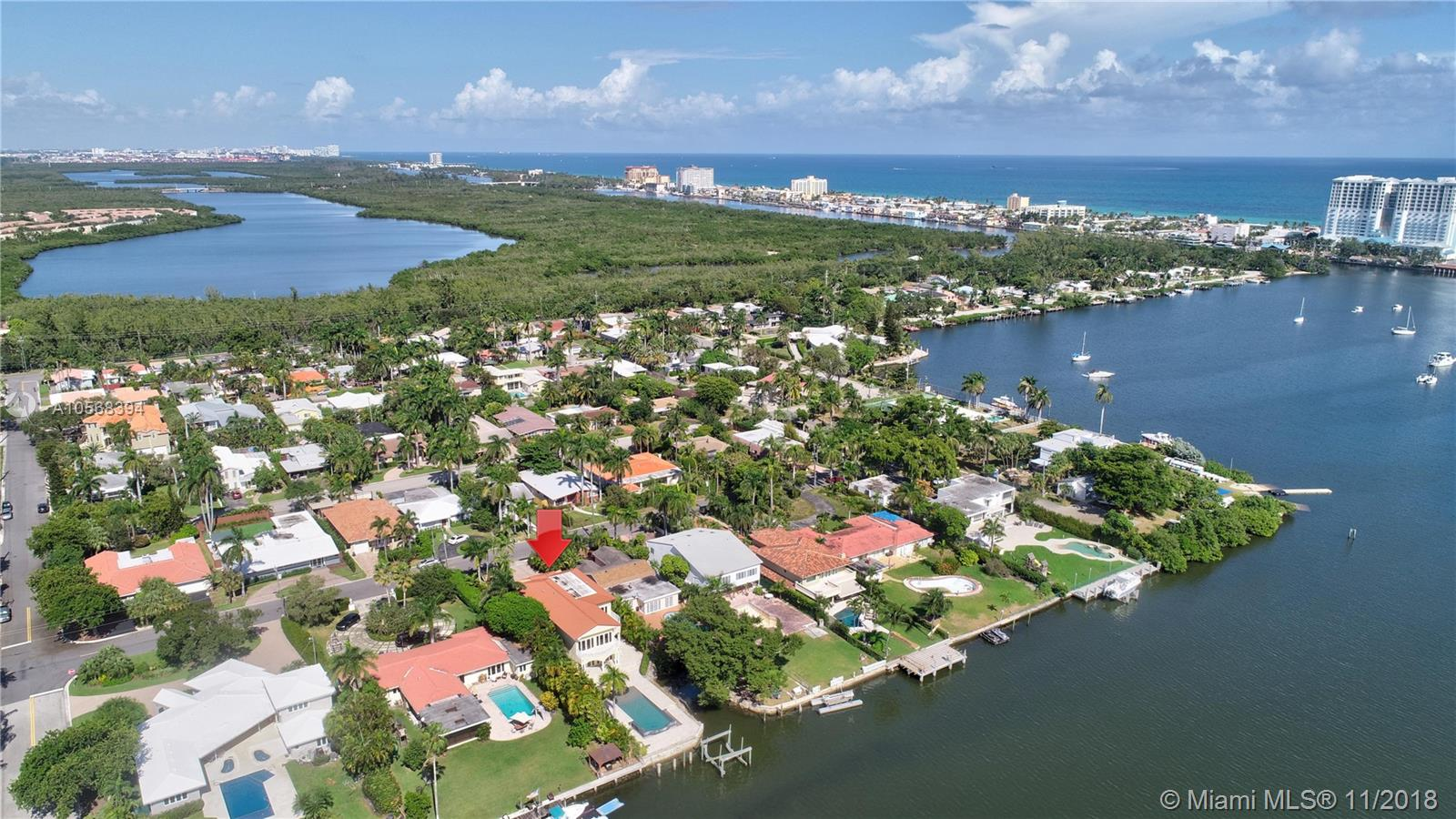 Incredible opportunity to live on the water w/ no fixed bridges and ocean access. Architecturally designed Pebble Tech Pool w/Beach Shelf entry, Spill over Spa w/bubblers & waterfall w/mote. Spacious bright living area, floor to ceiling glass & new Brazilian wood floors. Open Kitchen w/Gas Thermadore professional cook top, Subzero frig etc.  Prestigious Hollywood Lakes, centrally located, biking distance to Hollywood Beach. 2 balconies on second level overlooking the pool & gorgeous water views. Large Travertine Patio surrounding pool w/option for a Summer Kitchen-gas connection.Currently 5 bed 4 bath-has various options for different layouts-rooms for Media, Office, Summer Kitchen, Entertainment/Play Room...All Hurricane impact windows/doors. Generator ready. Must see to appreciate!