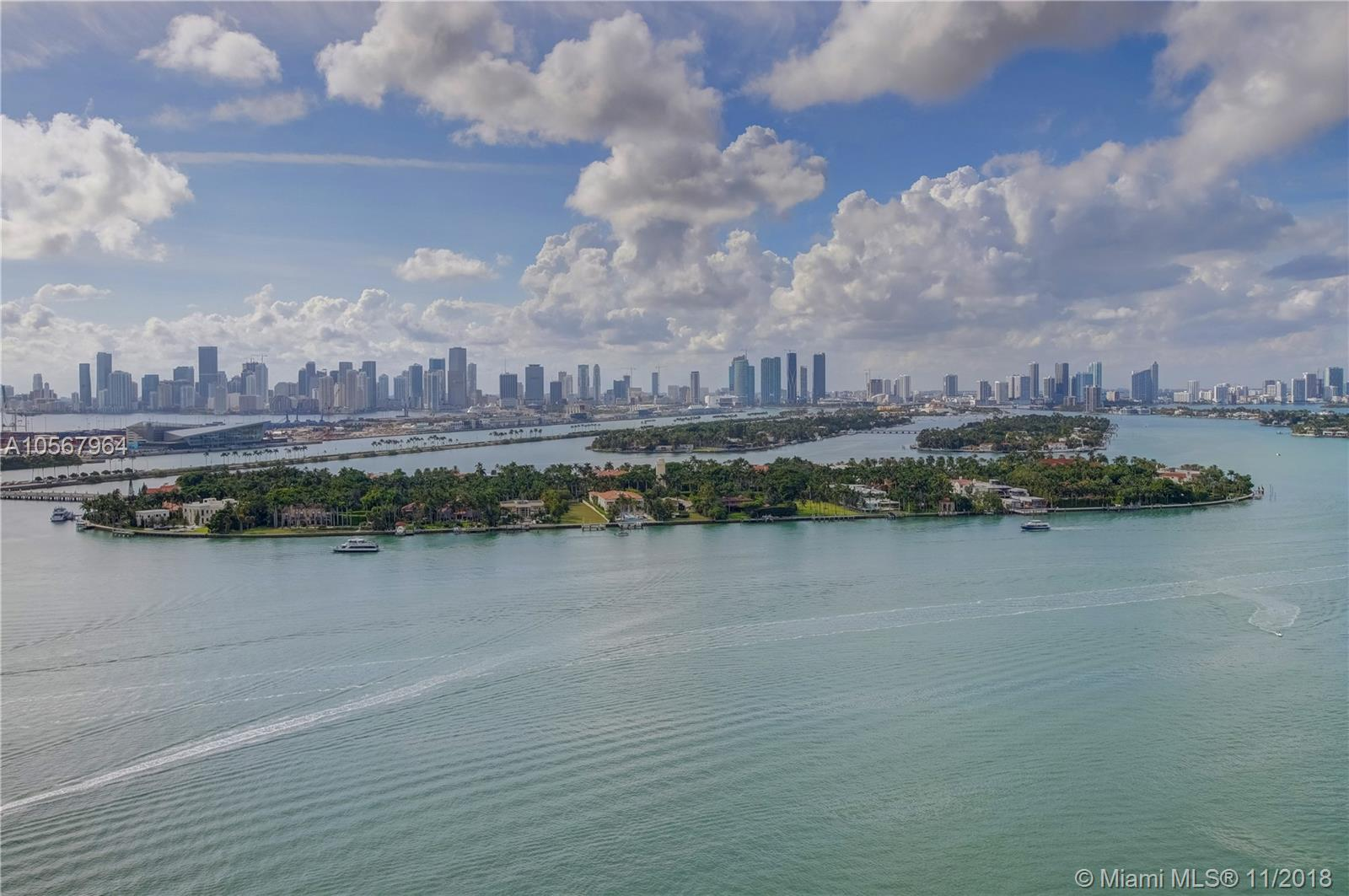 "Become one of a privileged few to enjoy the best Day AND Night views in Miami.  Views from every room.  Bay-Sunsets-Cruise Ships-Ocean...and more. This fully redesigned & renovated 3 bedroom layout was converted to a large 2/2.5 with nearly 1400SqFt.  The only one like it in the building.  Gut-renovated in 2017.  Just completed in 2018.  Exquisite wood flooring throughout.  Redesigned open kitchen with bar/countertop positioned to maximize the gorgeous bay views.  Enlarged living room.  Custom ""smart house"" with all lighting/temperature/music/etc controlled via smart phone or tablet.   Italian doors and cabinetry.  The highest quality fixtures and appliances.  All new AC and ductwork.  Painstaking effort made to open the space by removing soffetts, sprinklers. Custom lighting."
