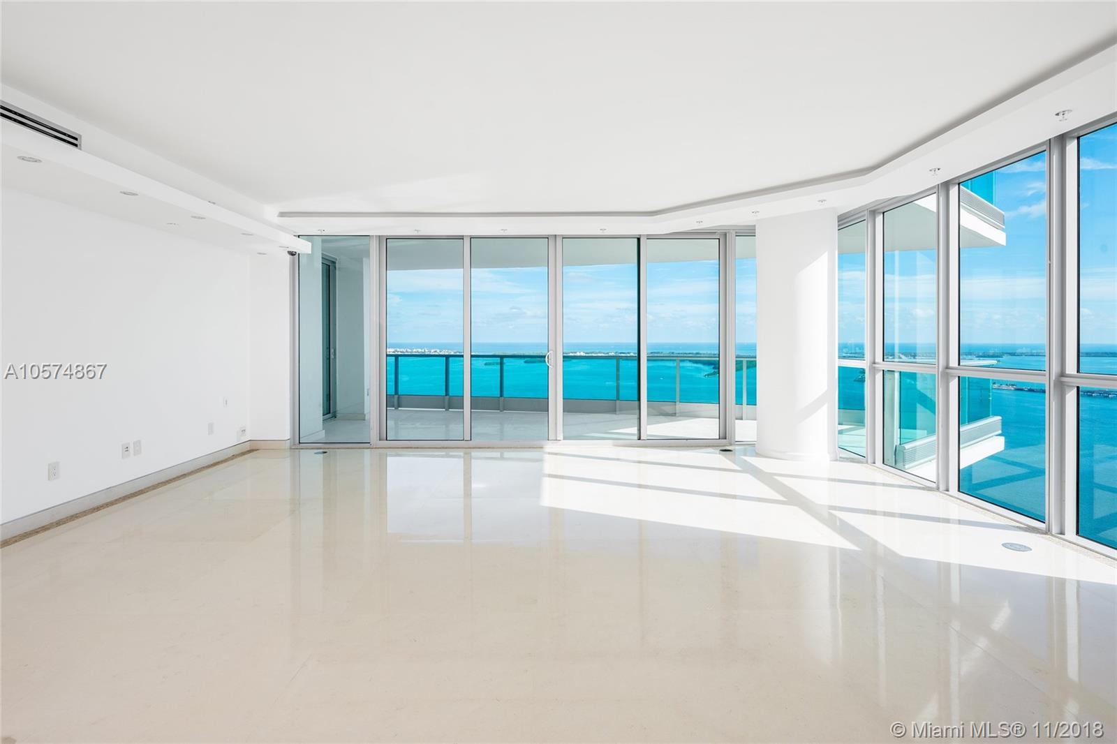 Located in the heart of downtown Miami this move-in ready unit on the 44th floor is truly stunning. The 4BR/4+1BA boast 3,415 SF, two large terraces and panoramic sunrise & sunset views as far as the eye can see over Biscayne Bay, Key Biscayne, Miami Beach, Atlantic Ocean & Miami. Beautiful stone floors throughout & wood floors in all bedrooms, open living & dining areas, family room & sleek gourmet kitchen w/top of the line appliances all w/incredible views. Large bayside principal suite features direct terrace access & amazing bathroom w/exquisite marble floors/walls, steam shower & Jacuzzi spa tub. Jade Brickell 5-star amenities include 24HR concierge, guest valet, health spa, gym, Resident Club Room, waterfront pool, party room & much more. This unit is truly a must see.