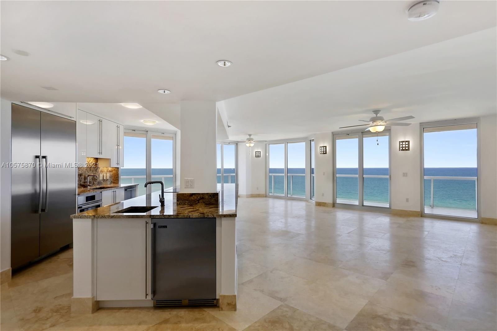 Magnificent 2BR/2.5BA split floor plan with panoramic, direct ocean views! Every inch of this 1,609SF residence has been newly & fully renovated with high-end finishes & all new top-of the line S.S appliances. New impact glass windows, sliding doors, 24X24 travertine stone floors throughout, large open kitchen with unsurpassed ocean views, wet-bar, granite countertops, custom cabinets & doors, new front loading washer/dryer, all new built-out closets, Master bath with double sinks, travertine counters, oversized shower/separate Jacuzzi tub. Most desirable corner unit in building. Approximately 431SF of wraparound terraces. Tenant will vacate unit on March 4, 2021.