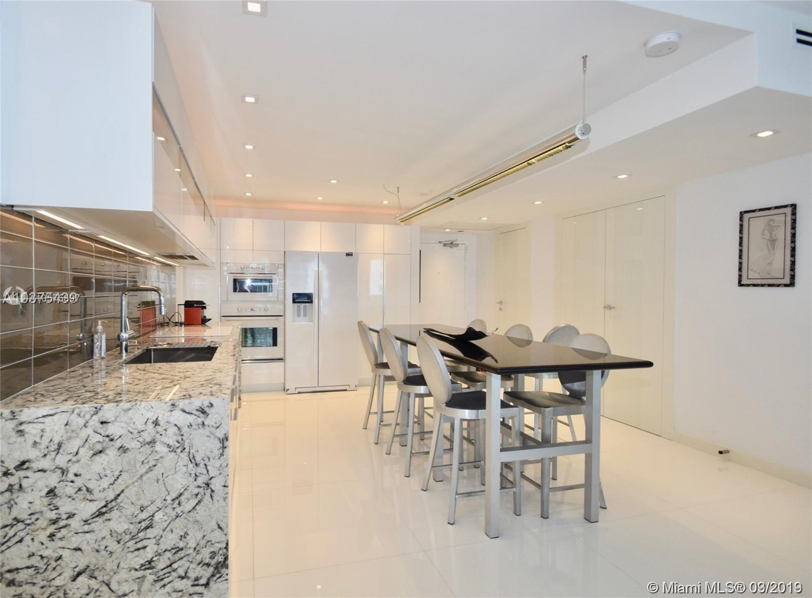 2301  Collins Ave   815/814