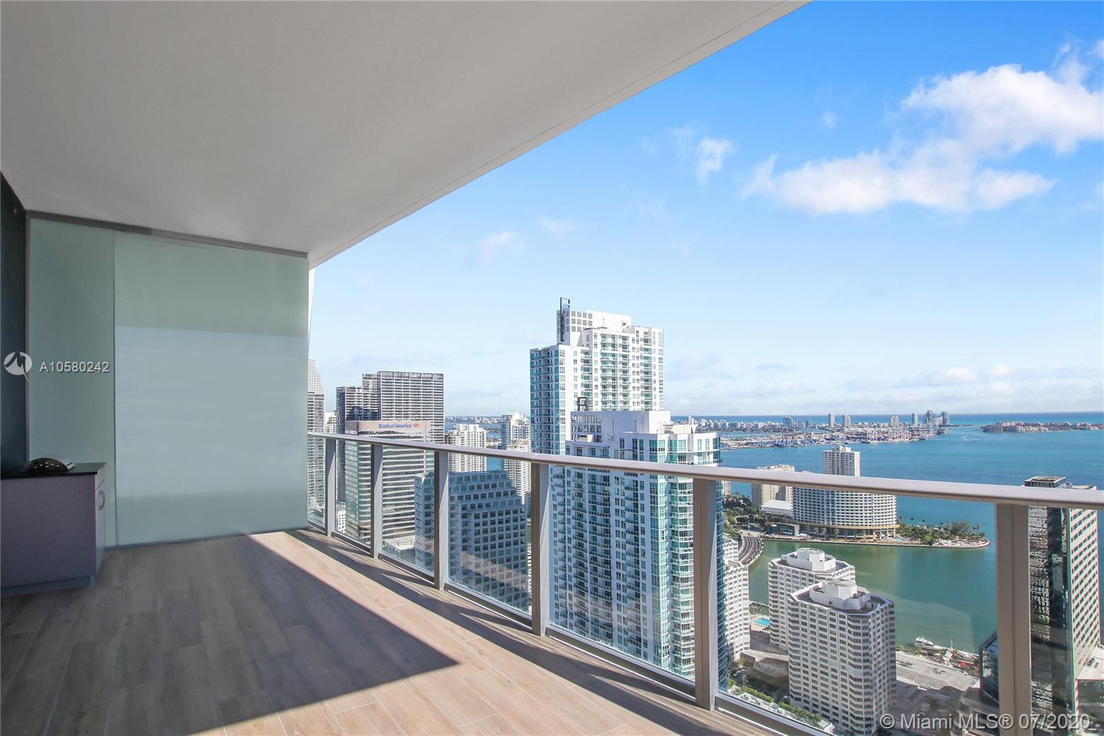 "Brickell 1010, new Luxury Urban Living with spectacular amenities for adults & children! Exquisite 47th Fl. 3bd + Den, 3bth with 180 degrees of Bay, Ocean & gorgeous City views, including bedrooms! Private elevator, modern European designer kitchen, bathrooms & finishes, developer upgrades throughout, floor to ceiling windows throughout & summer kitchen. Building offers incomparable amenities, 2 Pools (Heated & Rooftop), Basketball, Squash, Arcade, Mini Golf, Bowling, Jogging Track, Gym, Spa, Social Room, Movie Theater, Business Center, ""THE CLUB AT 1010"" on the 13th floor w/ parent/child pairing wristband system. Steps from Brickell City center, Mary Brickell Village."