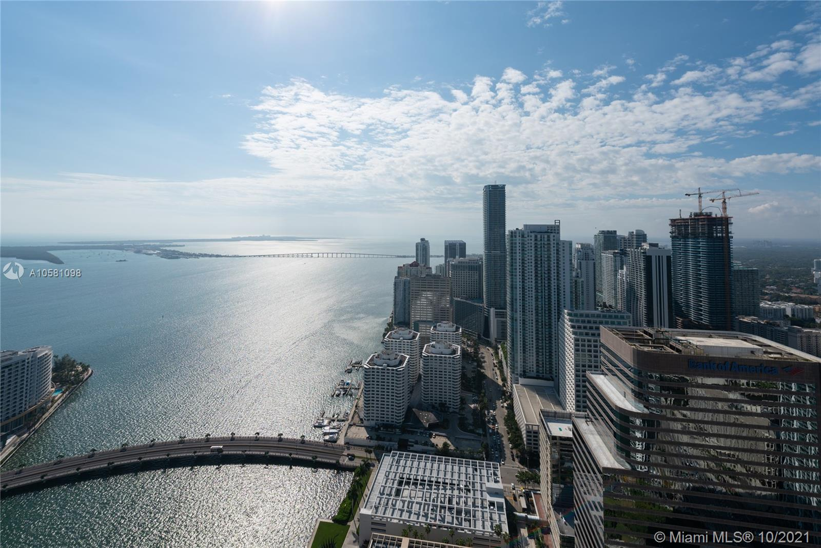 This beautiful 2 story Penthouse boasting incredible bay and city views. The second floor has an open bedroom with private bath that opens to an incredible terrace with hot tub overlooking the ocean. First floor, two bedrooms with high impact sliding doors to balcony. Marble floors, private bar area with wine cooler and open kitchen for a nice entertaining. In the heart of Miami, not far from Miami International Airport and Miami Beach, Design District.