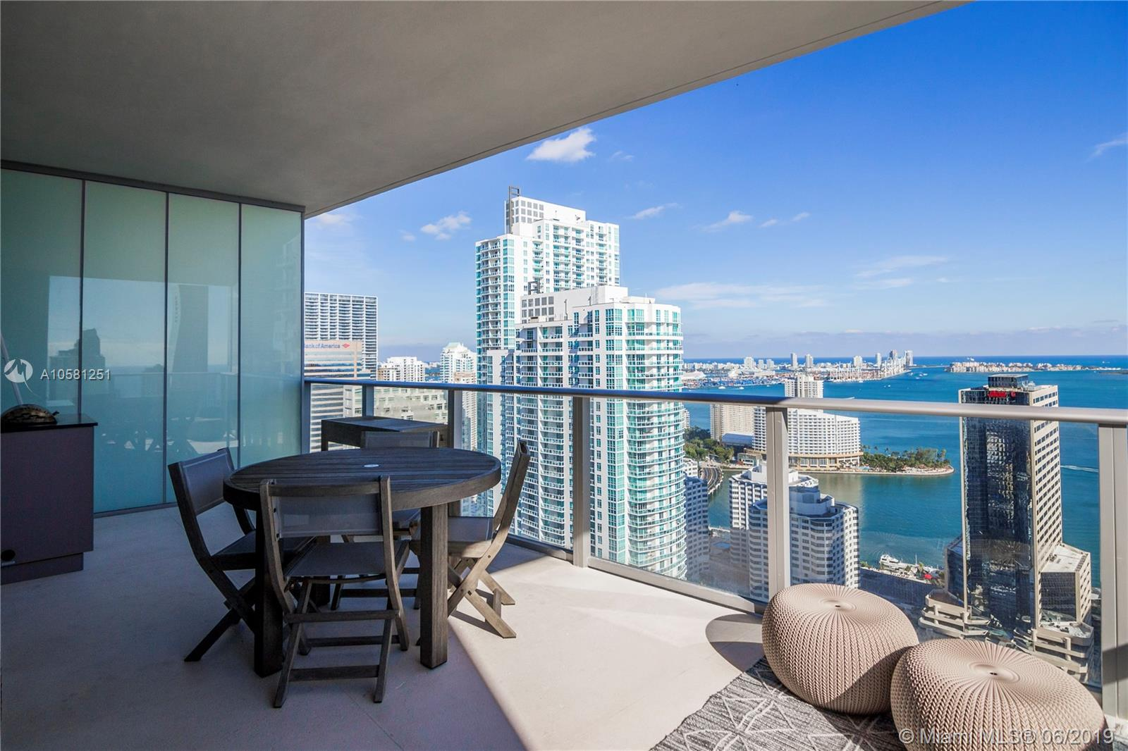 Enjoy breathtaking panoramic views of Biscayne Bay and Miami's skyline from this luxurious corner unit at the iconic 1010 Brickell condo. Unit features 3BD+Den/3BA, 1,778 sf, 48x24 Bianco Crystal Marble floors throughout, Chiseled Stone floors on balcony, European style kitchen, top of the line appliances, private elevator, 9 ft floor-to-ceiling windows, summer kitchen on balcony, 2 parking spaces & storage. Upgrades including white quartz kitchen counter-top, large kitchen sink, sliding-doors in master bath for privacy, lighting, and more. State of the art amenities: basketball and racquetball courts, bowling lanes & virtual golf, heated indoor pool, rooftop pool with restaurant/bar & BBQ area, gym, aerobics room, spa, sauna, steam room, kids indoor playroom, running track...