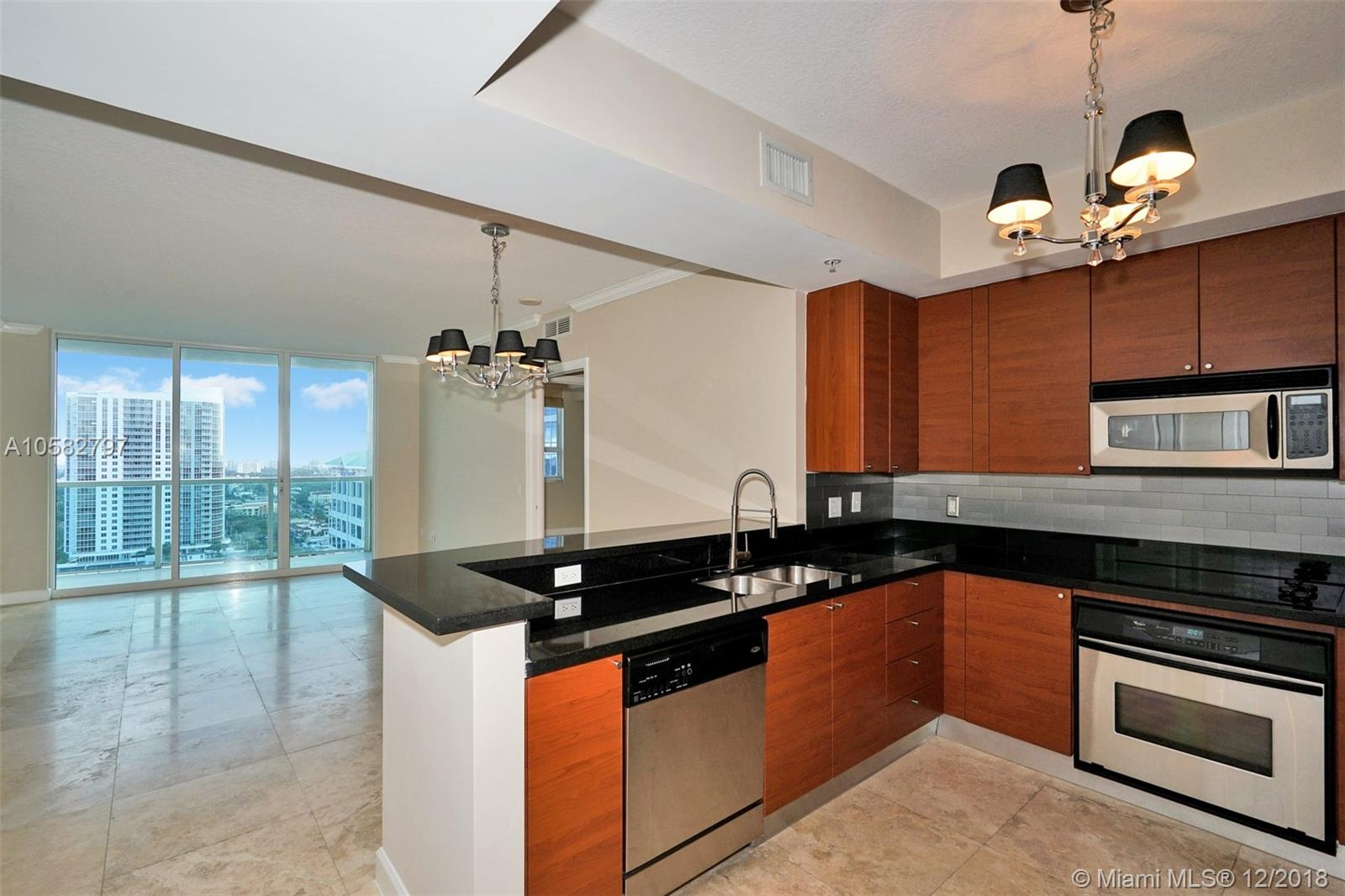 Investors Dream - Collects $35,400 annually.  City and Ocean views from every room.  Saturnia marble throughout, stainless steel appliances and large master bathroom.  5 star amenities including a roof top pool, fitness center, movie theater, valet parking and 24hour doorman.  Building comes with upgraded cable (HBO) and wifi.  Walk or ride your bike to  the beach.  Minutes to the airport.  Maximum of 2 pest (under 50lbs).  See Broker Remarks