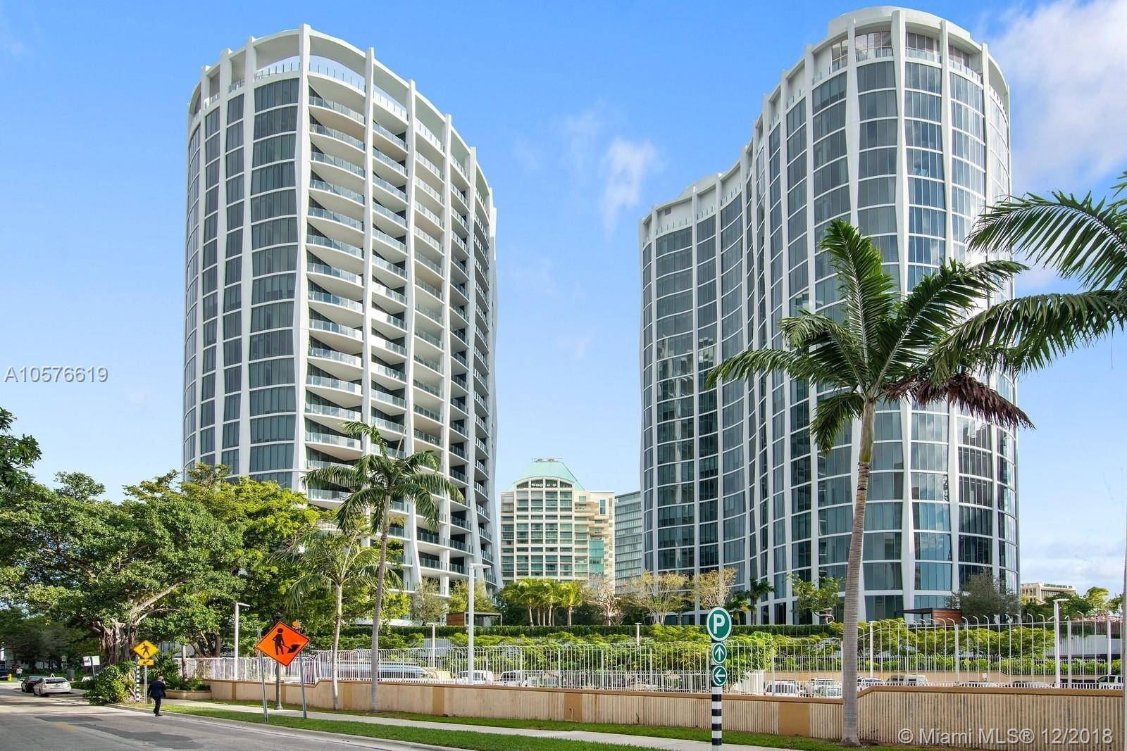 Unique Floor Plan! Two units combined! 3 Suites + Powder Room (2 master suites) approximate 1,886SqFt under AC. 10 foot floor to ceiling glass over looking Coconut Grove. Brown porcelain wood  throughout the unit. Terrace has white wood porcelain. Expansive dinning and entertaining area. Bedrooms with en suite bathrooms; his and hers vanities. kitchen has light oak wood trim, paonazzo marble, bronze mirror backsplash and off-white glass Italian cabinetry. kitchen with island, wolf & subzero appliances. Unit comes with 2 parking spaces.