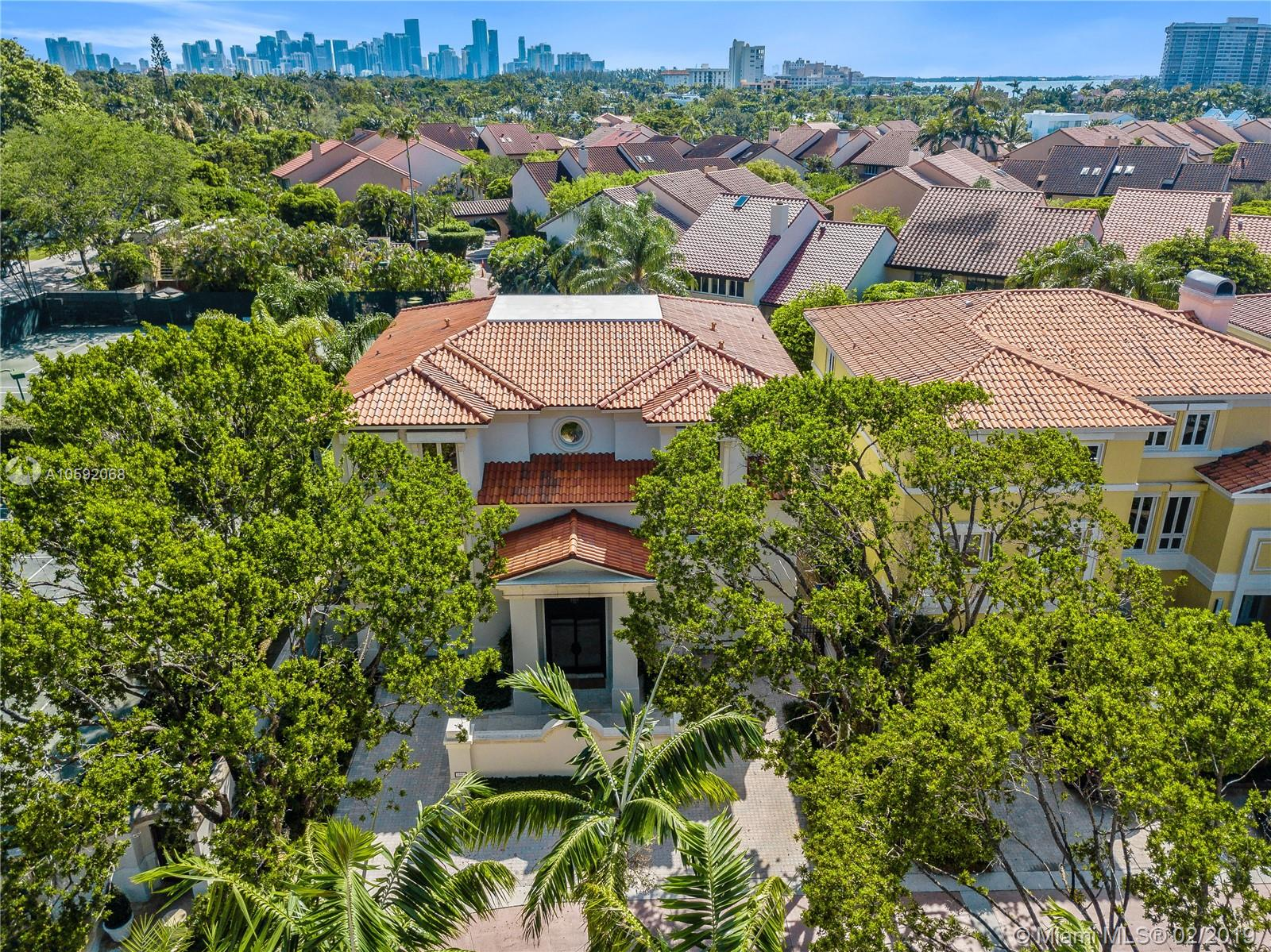Welcome home to guard gated Bayshore Villas, located in Coconut Grove just south of Downtown Miami and Brickell Avenue.  This gorgeous villa has over 5000 square feet of living space with 4 large bedrooms each with its own bathroom, the huge master bedroom has two well appointed master baths. Cypress wood and bamboo ceilings throughout the living rooms please every visual sense a buyer is wishing for in their home.  The kitchen features a butlers pantry, top of the line appliances and an adjoining breakfast room.  This amazing home must be seen to be appreciated.  Community pool, Tennis courts and dock is a great place to take in the views of Biscayne Bay.  Walk to everything Coconut Grove has to offer including world class Marinas one block away.