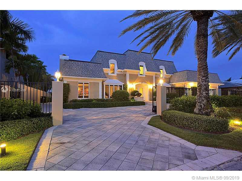Classic luxury home in the prestigious island community of SUNRISE KEY consisting of 75 waterfront homes w/ police patrol and one gated entrance.  100 feet of waterfront, ocean access with on fixed bridges.  Up-dated throughout w/ exquisite custom finishes & mill work.  Gourmet gas kitchen, unique outdoor covered veranda w/ full stainless steel summer kitchen equipped with pizza oven.  Marble & hardwood floors throughout, sauna, 6 beds/5 baths, gas generator, central vac.  Close proximity to downtown Ft. Lauderdale, the airport, fine shops and dining. Conveniently located within minutes of Whole Foods and Fresh Market.