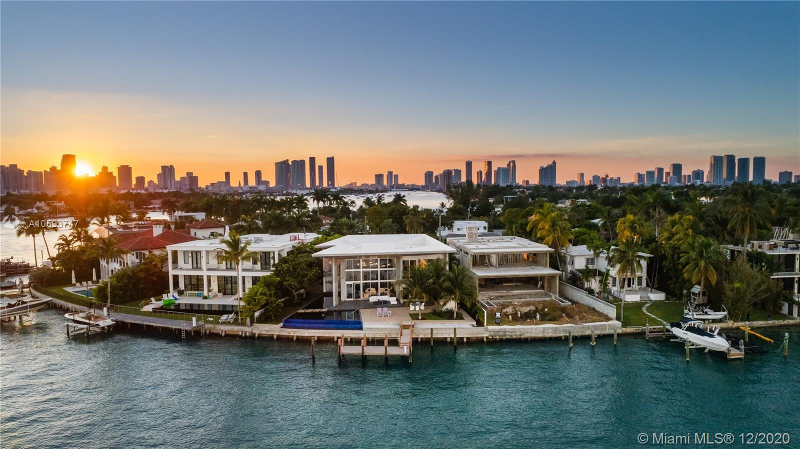 Architectural modern masterpiece and one-of-a-kind work of art on coveted Venetian Islands! The art connoisseur, interior design lover,and future owner will revel in this fully custom awe inspiring home.Boasting expansive Biscayne Bay waterfront views, soaring ceilings mixed w/cantilevered concrete & voluminous glass, floating sculpture staircase w/illuminated black quartz, unique 19ft NOA rated entry door never again replicated and interior tropical garden w/sustained irrigation system. Chef inspired enormous tailor made Snaidero kitchen & bar w/temp controlled glass wine room is an entertainers dream! In addition, each of the 5 bedrooms have en suite baths & fully built out custom closets, 2 separate family rooms w/incredible views, commercial grade elevator, and 3 car collectors garage