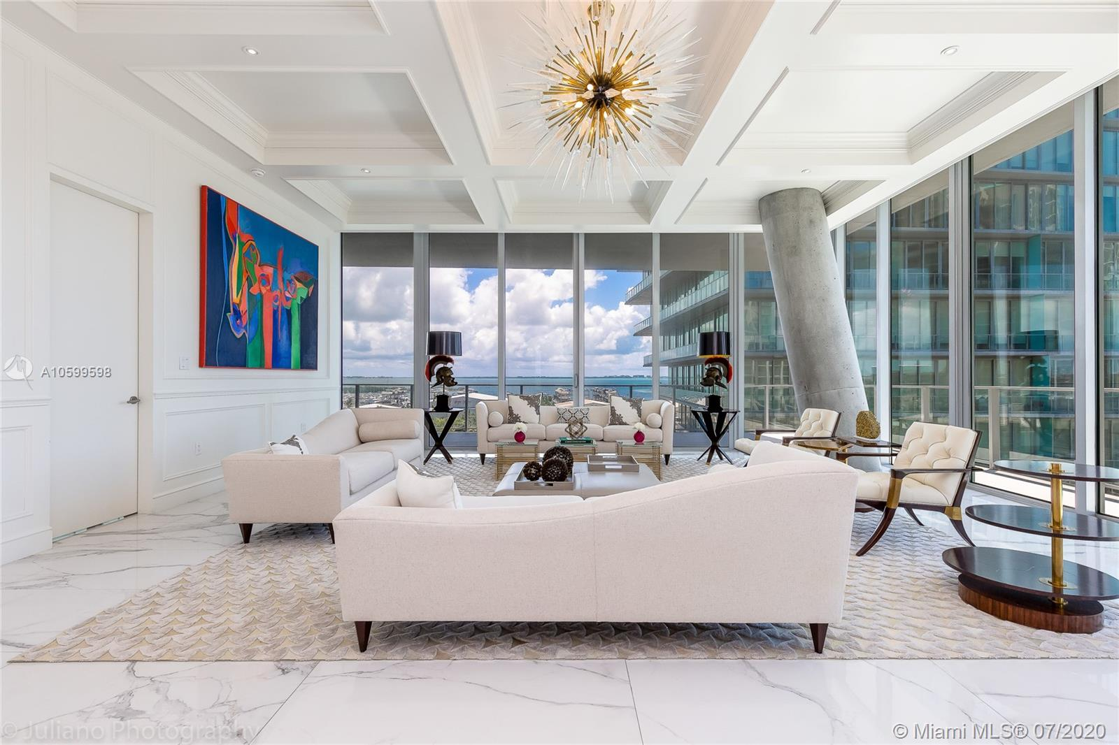 Gorgeous corner 3 bedroom plus staff quarters and 4 1/2 baths residence located in the most iconic building in Coconut Grove; Grove at Grand Bay. Designed by award winning architect Bjarke Ingels. This residence is exquisitely finished with vaulted ceilings, leather accent walls, custom woodwork, and much more. A must see. Private elevators take you directly into residence with magnificent South East exposures of the Bay. Over $400k in finishes. Most sought after building in Coconut Grove. If private, boutique and exclusivity is what you are looking for, this is the building for you. Wrap around terrace. Miele stainless steal appliances, Snaidero Cabinetry, Gas cooking. A home in the sky. Gorgeous landscaping by Raymond Jungles. Service is superb. Private Restaurant for owners.