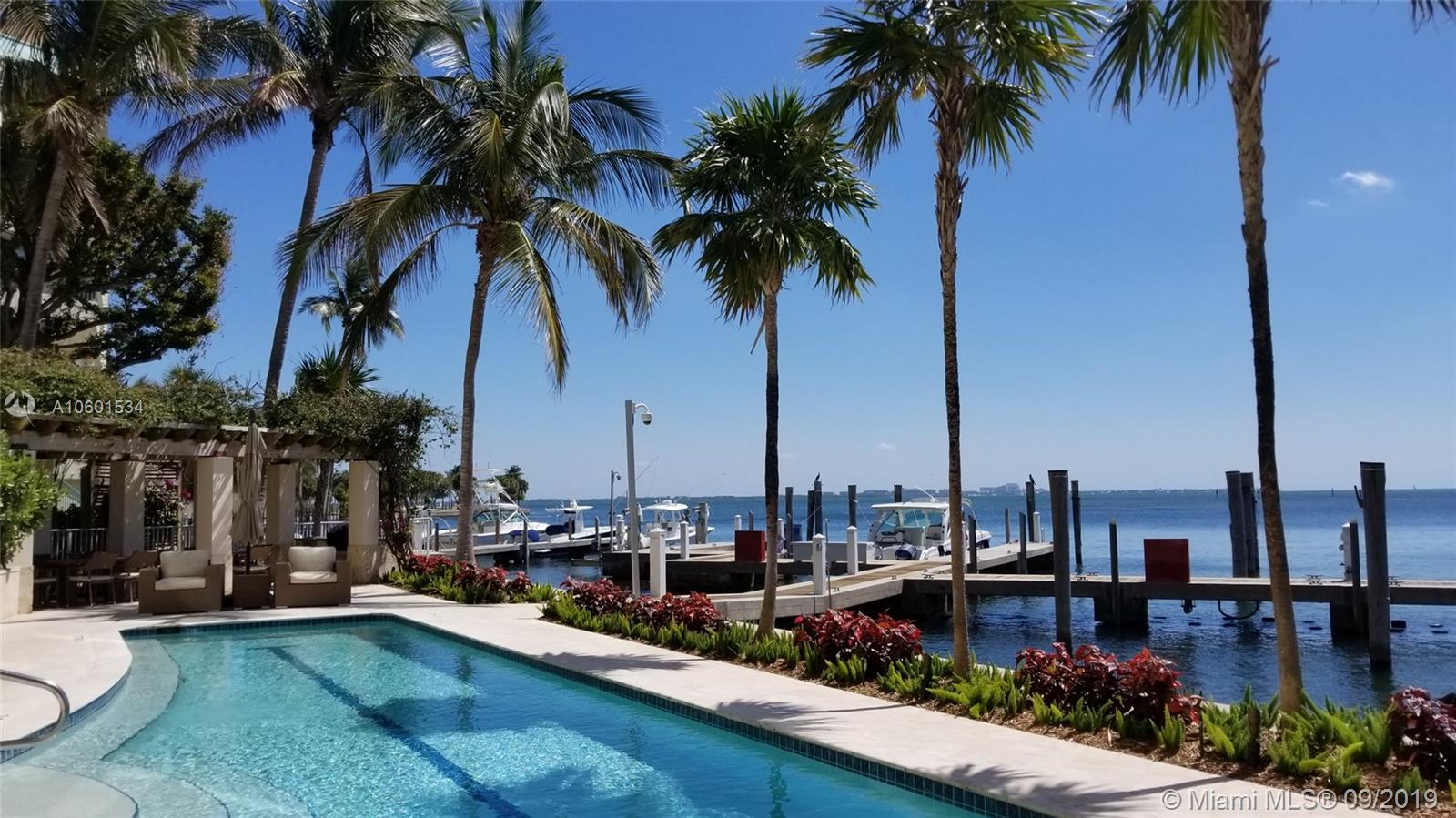 Waterfront luxury residence in the heart of Coconut Grove with direct ocean access and 2 boat slips included; currently asking $863/sf. This exclusive residence offers expansive water views right on Biscayne Bay, beautiful wood floors throughout, high ceilings, impact windows, open floor plan comprising of ample living, dining, Poggenpohl kitchen, breakfast nook, 4 bedrooms, 3 bathrooms and 3 terraces; only ten residences with private elevator entry and foyer. This boutique building offers tranquility and incomparable life style, lobby renovated, new roof and new A/C about 1 year old. Amenities include 60 ft heated lap pool, Jacuzzi, exercise room, BBQ area and deep-water Marina.