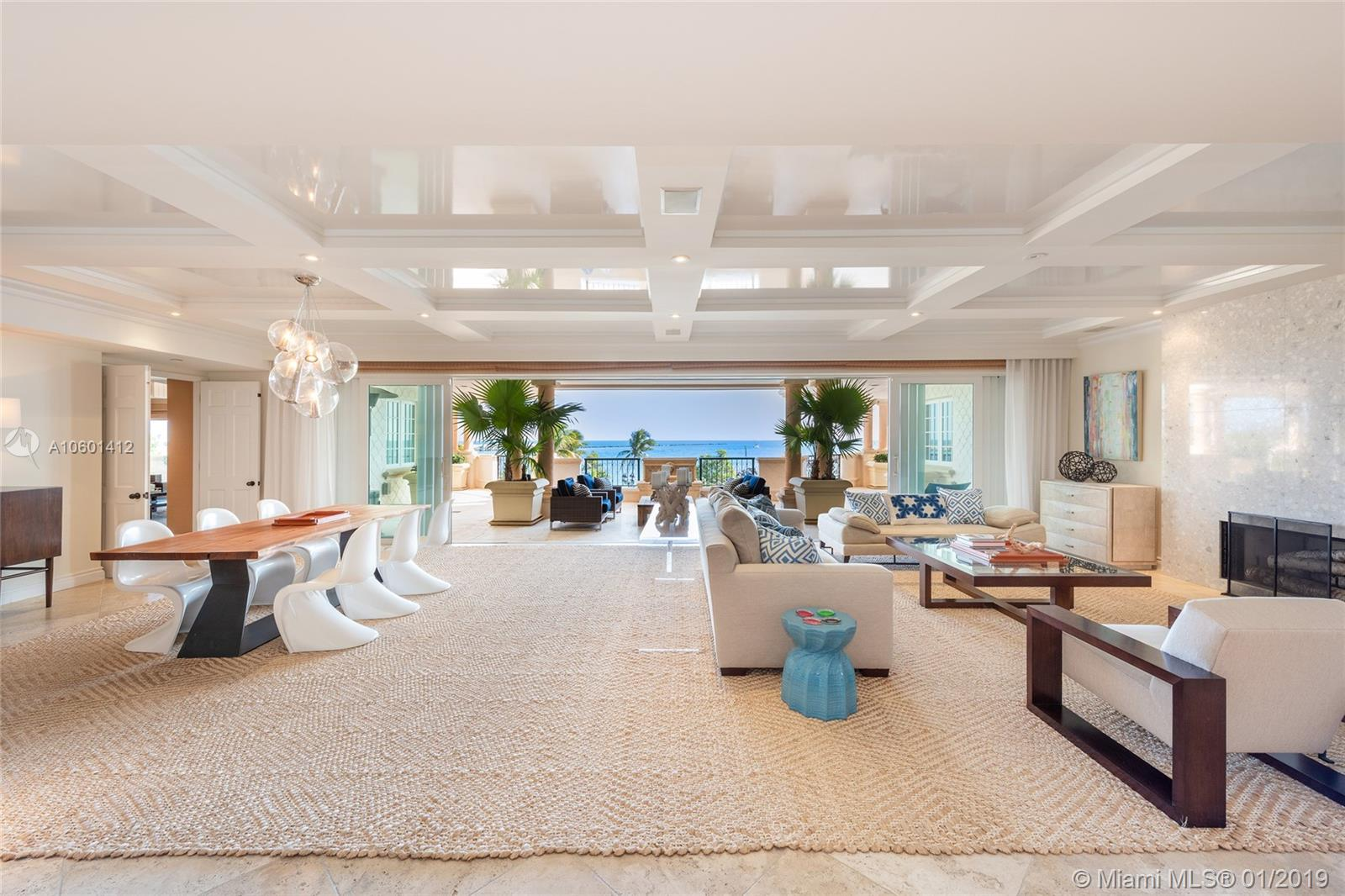 This contemporary Oceanside corner unit sits as the coveted tip of Fisher Island w/unobstructed sunrise views to Government Cut, ocean, beach & Miami Beach. The 5BR/6+2BA unit boasts 6,820 SF of interior space w/beautiful Travertine marble floors, open dining & living room layout w/a fireplace & walls of glass that open to endless ocean views. The gourmet kitchen sports top of the line appliances & a separate breakfast area & the large family/media room is ideal for relaxing & entertaining. The Oceanside principal suite is amazing w/direct ocean views, separate dual baths each w/voluminous walk-in closets. The other 4 bedrooms each w/en-suite baths. Watch the parade of cruise ships from your expansive wraparound terrace w/multiple seating areas to relax & enjoy the ocean views.