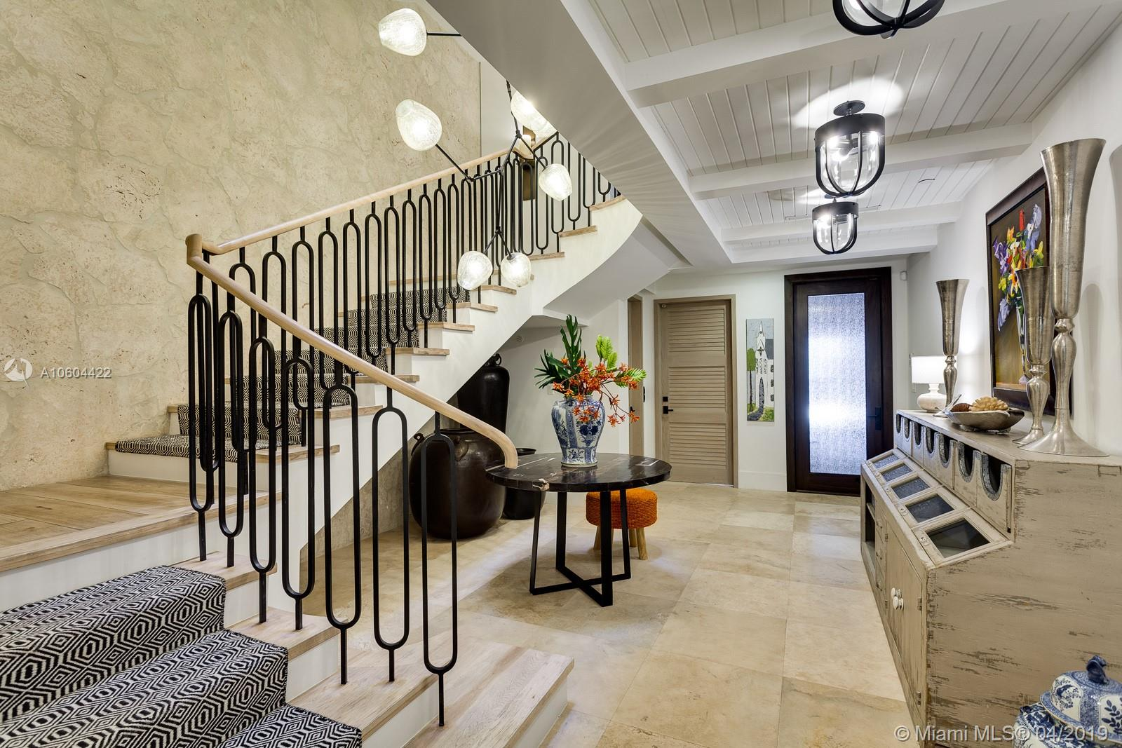 Searching for the 'stand out' home in Coconut Grove? This magnificent Villa at private Cloisters on the Bay checks all of the boxes. Re-designed & renovated by Taylor & Taylor in 2018, every inch exudes beauty & warmth. Dynamic main level seamlessly blends elegant dining & living spaces, dreamy office, full bar, & over-the-top MiaCucina eat-in kitchen. An enclave of 3rd floor bedrms, all ensuite, are designed to metropolitan perfection. An amazing roof-top oasis & summer kitchen are a fabulous backdrop for entertaining & star gazing, and for guests, a completely private suite features bedrm, bath, kitchenette, & living area - 5-star accommodations! The details & appointments are endless – remarkable surfaces, dual-sided fireplace, elevator, & 7 parking spaces to name a few. Flood Zone 'X'.