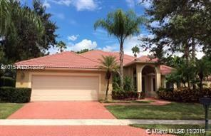 MOTIVATED SELLER. GREAT REDUCTION FOR FAST SELL. EASY TO SHOW.BEAUTIFUL SINGLE FAMILY HOME, ONE STORY  ON WESTON HILLS CC, GOLF COUSE VIEW, FEATURING 5 LARGE BEDROOMS AND 4 FULL BATH ROOMS. VAULTED CEILINGS, GOURMET KITCHEN, CERAMIC TILE FLOORS, PLANTATION SHUTTERS, WOOD LAMINATE IN BRS., LARGE PATIO W/SCREENED IN POOL & SPA OVERLOOKING THE GOLF COURSE. ELECTRIC HURRICANE SHUTTERS, MASTER BATH WITH STEAM SHOWER, SPLIT FLOOR PLAN,  EASY TO SHOW!