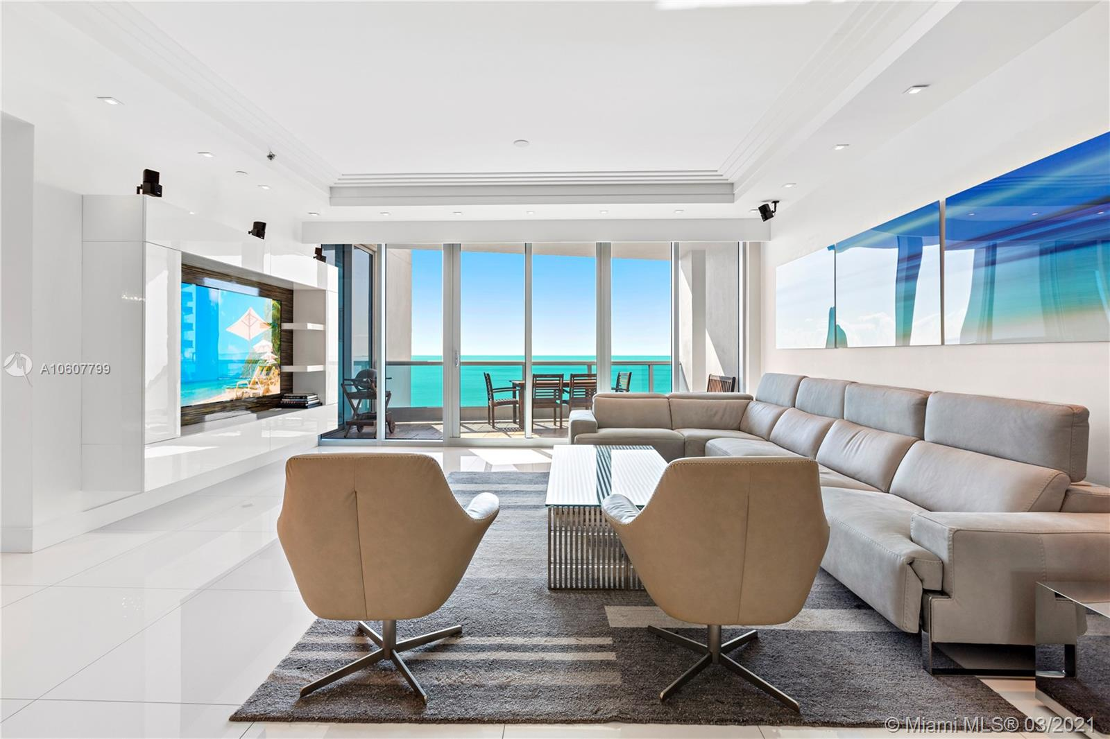 MODERN & MINIMALIST OPEN SPACES IN THIS COMPLETELY RENOVATED OCEANFRONT RESIDENCE PERFECT FOR ART COLLECTORS WITH FAMILIES! Enter Private Foyer into just under 4,000 SF of Contemporary Living w 10FT ceilings & Floorthru Views of Beach & City. Split Floorplan w Slabs of White Glass floors, Lacquered Zebrawood Doors & upgraded Lighting. Direct Beach Views from Eat-in Italian Kitchen w Miele Apps. Master Suite w His & Hers closets & Bath w White Lacquer floating Vanities, Marble Rain Shower w Steam, Spa Tub wrapped by textured walls. Comfortable loungey Media Rm + 2 private corner Guest Suites + Study overlooking City & Bay. 2 Terraces for Sunrise & Sunset Views! The Bath Club 5 Star Resort Amenities: Tennis Courts, Full Service Pool & Beach Club, Gym + Spa, Concierge, 24-hr Security + Valet.