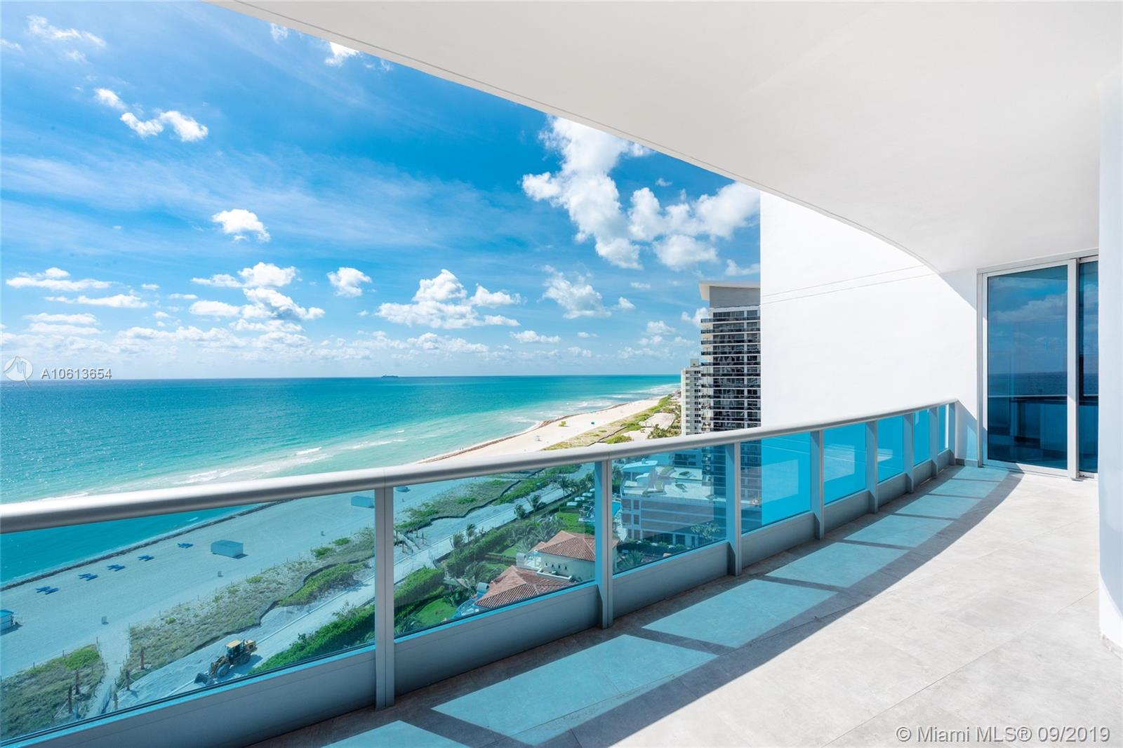 Spectacular direct oceanfront unit at the luxury Bath Club. The sleek and chic unit features 3,807 SF of luxury with white Italian porcelain floors throughout and two sweeping terraces with unobstructed sunrise views to the beach & Atlantic Ocean as well as city, bay and Downtown Miami sunset views. Offers an expansive open living, dining and family/media room layout all with amazing ocean views & an Oceanside gourmet kitchen with top of the line appliances. The private & elegant oceanfront principal suite features separate dual walk-in closets, and principal bath w/ glass rain shower & Jacuzzi spa bath. The other 3 bedrooms are each spacious with en-suite baths and includes a larger guest suite. 5-Star Bath Club amenities complete this amazing offering.