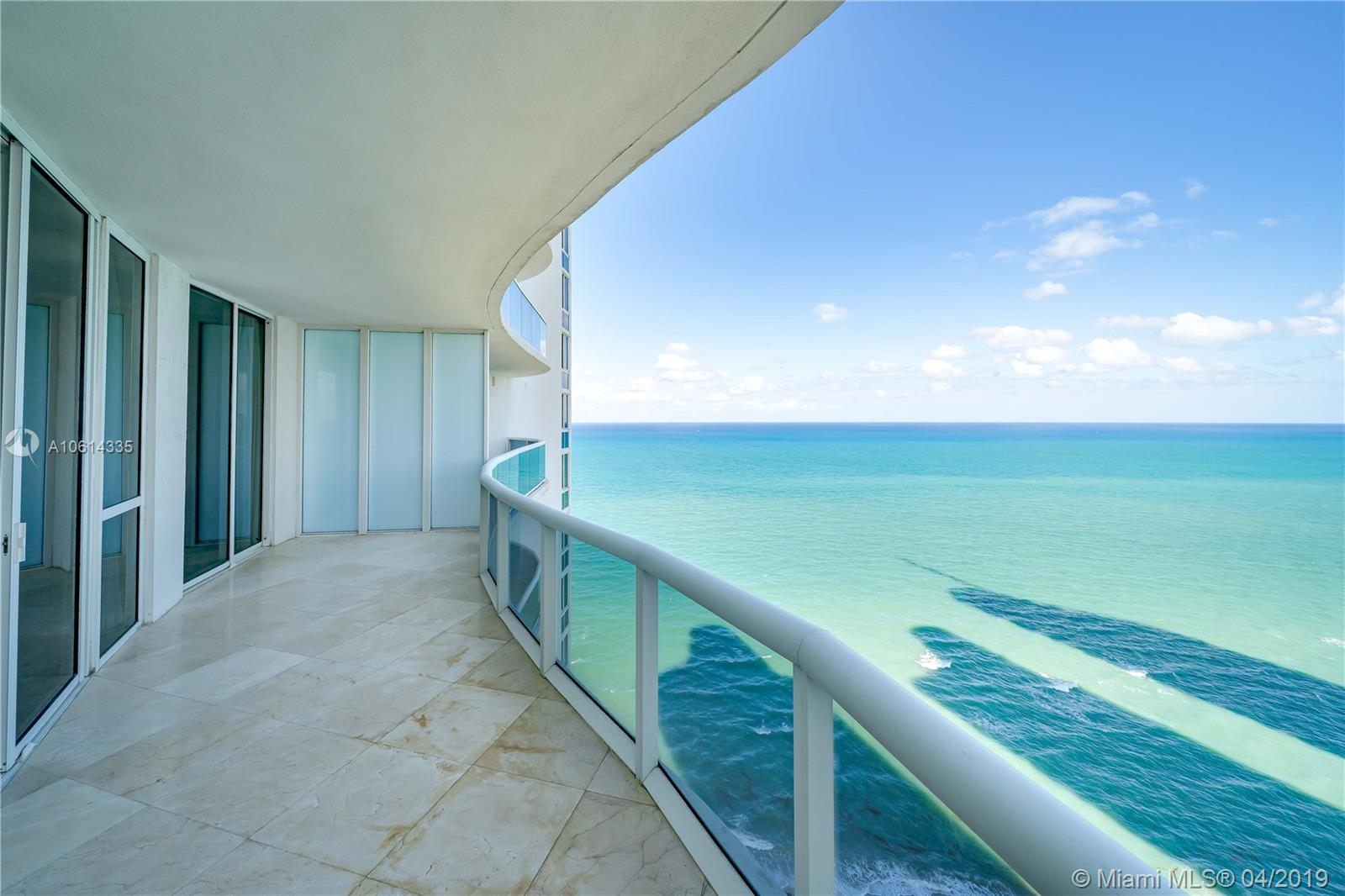 Wow! Enter this spectacular Oceanfront residence from private elevator foyer and immediately + throughout see the fantastic SE views of Direct Ocean, Intracoastal, and City Views. 2 bedrooms + Convertible Den with its bath. All bedrooms are ensuites  This was a 2nd home and rarely used. Views from every room through floor to ceiling windows, 10-11 ft ceilings. Open kitchen w/ Italian cabinetry and Subzero/ Wolf appliances. Meticulously maintained and MOVE IN READY! Amenities include 7000 sq. ft Spa/ Fitness Center + Yoga Studio overlooking the ocean. Heated Pool, Beach side Concierge with chair and towel service = 5 star experience.  Across from Intracoastal Park! World famous shopping at Bal Harbour is just minutes away!