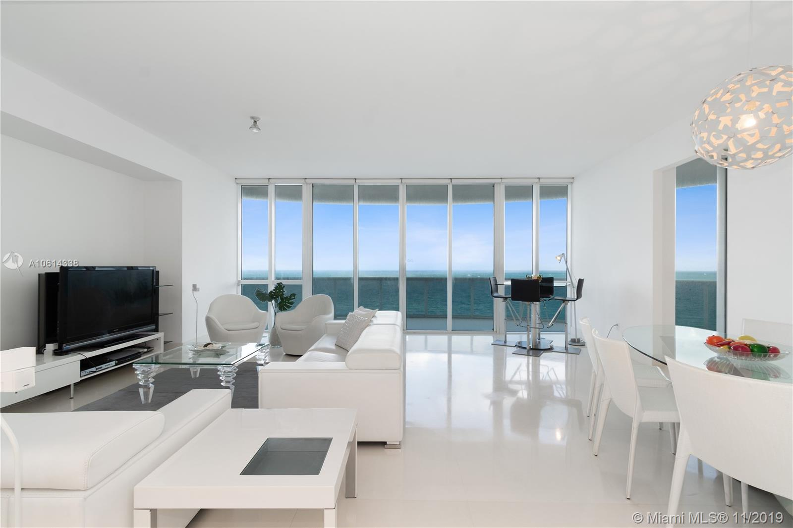 Best and largest coveted line in the Luxurious Trump Tower I with 5 star Amenities in the heart of Sunny Isles Beach. 11' clear ceilings & huge balcony with spectacular unobstructed panoramic views over 48' linear feet of direct oceanfront & Intracoastal views from every room. Magnificent 3 bd/ 3.5 ba residence is finished with Crema Marfil marble on floors & walls in bathrooms, modern Open Kitchen with floor to ceiling glass & terrace access, Sub Zero fridge, dual temperature wine cooler. Most furniture included, furniture direct from Italy! 2 parking spots in the best exclusive area. Amenities include 4 pools, spa, fitness yoga classes offered with licensed instructors, business center, beach & room service, gourmet beachfront restaurant.  Across from Intracoastal Park!