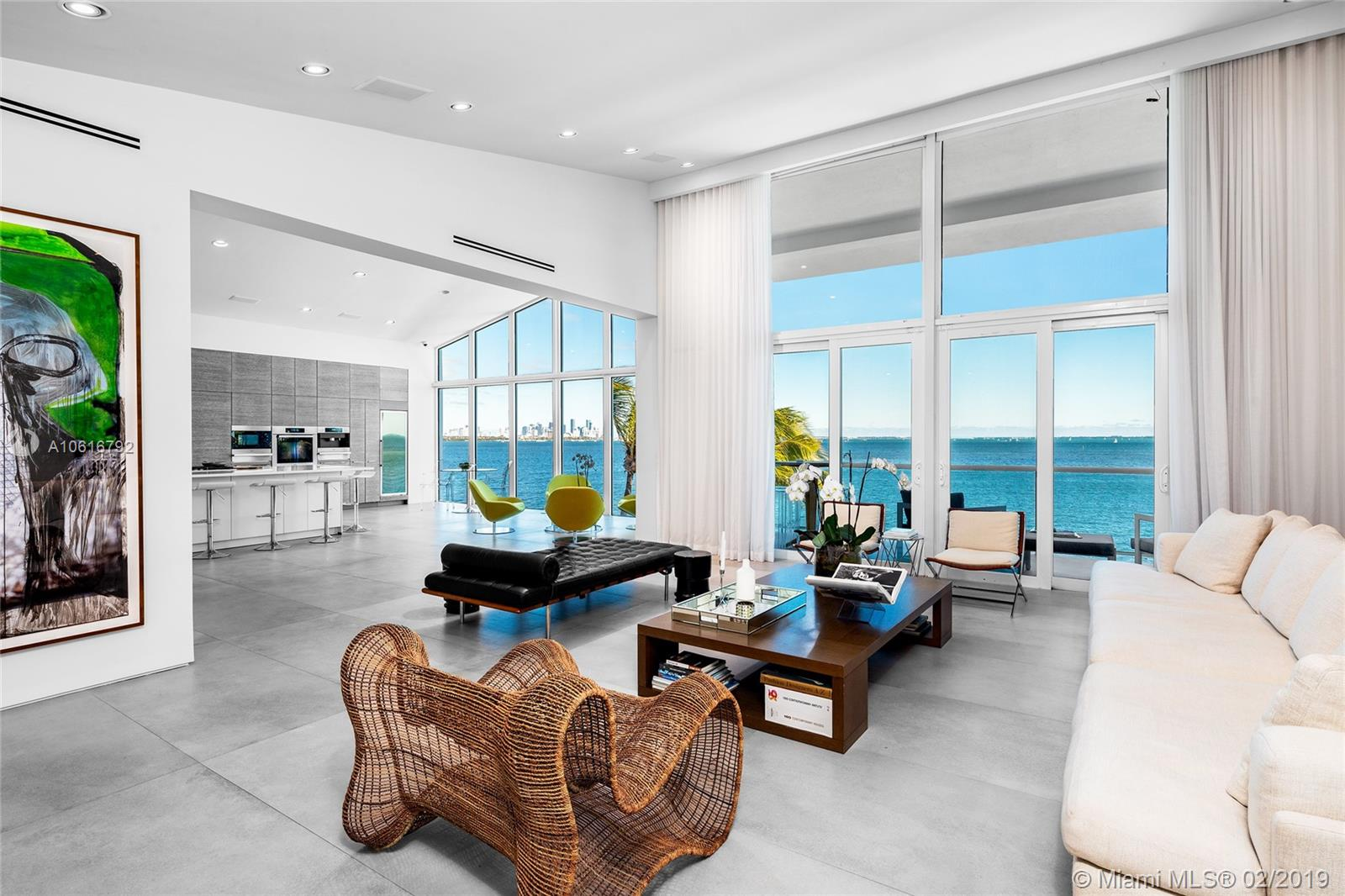 This stunning contemporary tri-level residence located in the desired gated Sunrise neighborhood sits directly facing Biscayne Bay w/sweeping unobstructed open bay, downtown skyline & Key Biscayne views. Residence boasts 5BR+gym/6+1BA, stone floors throughout, soaring ceilings, interior elevator & masterfully designed open floor plan. Amazing 3rd level features a spacious living room w/soaring ceilings, private dining room, & custom designed gourmet kitchen by Alno w/Miele appliances. Beautiful bay-facing principal suite with terrace access, Carrera marble bath, custom closet spaces & open bay views. Outdoor highlights feature covered lounge area, large pool w/Jacuzzi, private dock w/boat lift & 100 FT of sparkling waterfront in Miami's most prime location. Dual 500 tank mega generator.
