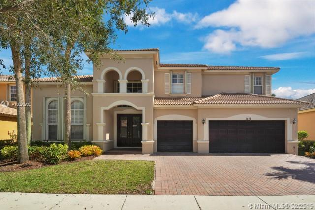 Location...Location...Location! This beautiful home is located in the exclusive gated community of  the Isles of Weston. The home boast an amazing floorplan, From the moment you walk-in...with high ceilings and room for family outings and parties. It's a must see to appreciate! Call me for a private showings.