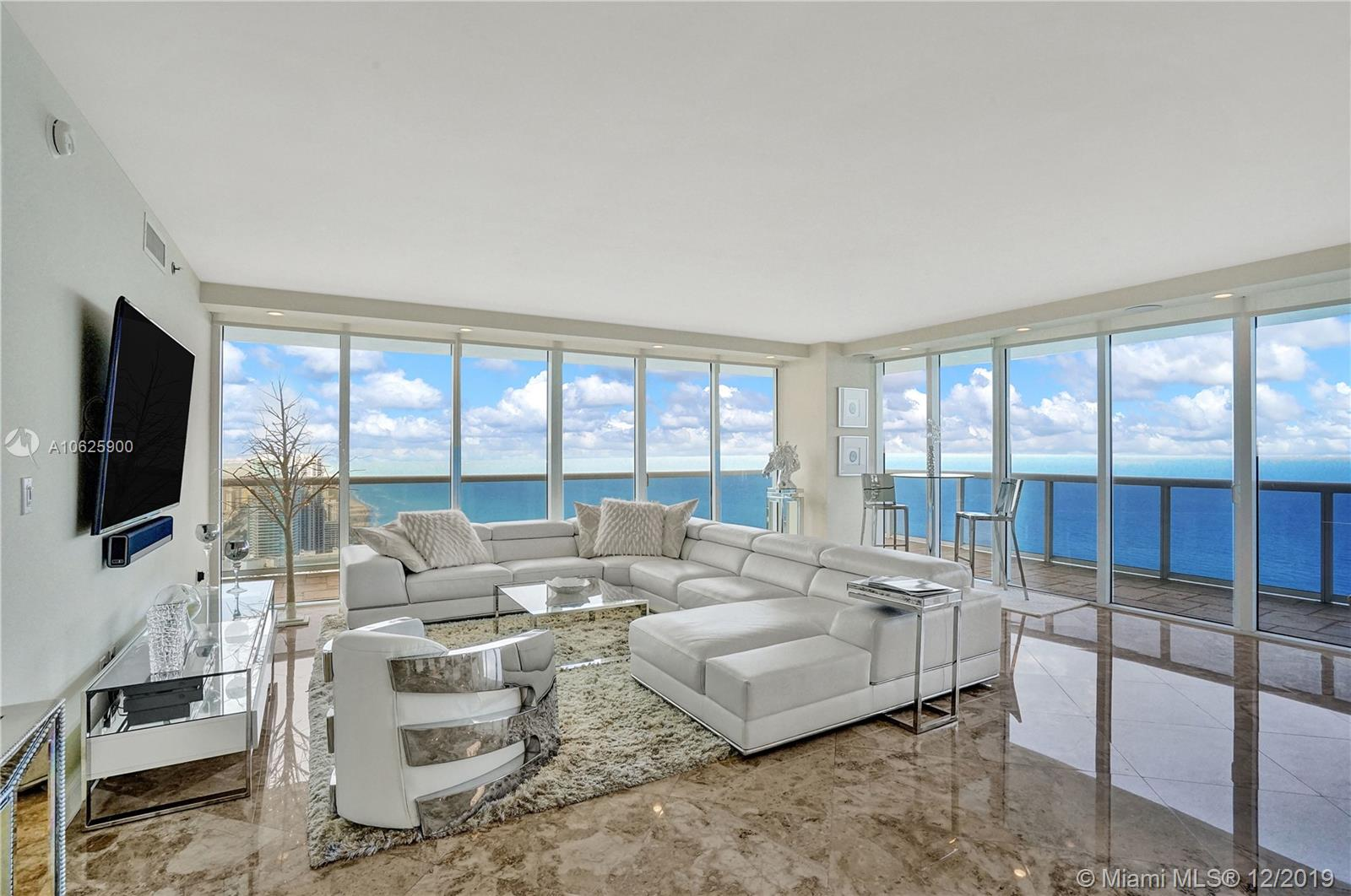 Spectacular corner unit on high floor offering views to South Beach looking south and to Fort Lauderdale looking north. Watch cruise ships sailing by as you relax on your 586 sq. ft. balcony! The apartment has been substantially renovated & meticulously maintained. Gorgeous kitchen with stone quartz Calacatta waterfall countertop. Bamboo Eurostyle cabinetry & Kitchenaid appliances. Marble floors throughout. Surround Sound System. Master bath also has stone quartz Calacatta counters and new dual sinks. Soffits have been installed throughout the apartment with LED lighting. Custom made folddown Murphy bed system in the den will stay. Custom sliding glass doors on den for added privacy. Comes with one of the best assigned parking space. Call today. Easy to show. Please see brokers remarks.