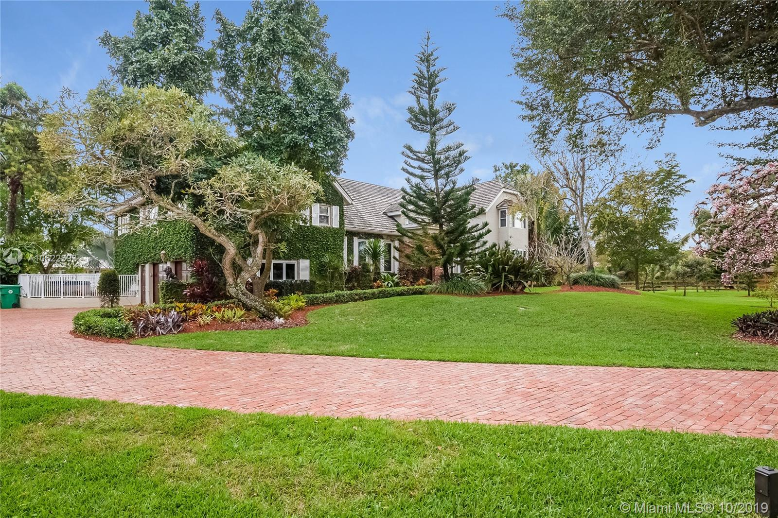 Magnificent, one-of-a-kind estate, northern charm and architecture in this remodeled, comfortable home on 2+ divisible acres, large bedrooms and beautiful office/den, 7,000+ sq ft. built. Impact windows and doors, abundant storage space. Enjoy reading in the gorgeous sun-room. Cook for 2 or 20, very well-appointed kitchen, built-in closets, all bathrooms updated, marble & natural stones. Large master suite with big terrace, 5-year-old-roof with warranty, lovely fully-fenced grounds with a 4 stall barn w/ tack room & fenced paddocks. Access the Davie Trail system for your horse rides. Great patio, large pool, private stocked pond, gazebo and canal. Large emergency gas power generator, storage tank, and a hot tub to relax after a hard day. Elegance, space and privacy, you can have it all!