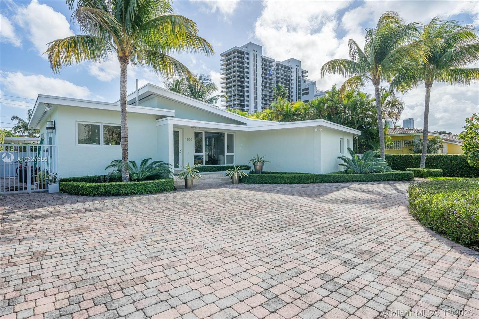 New price! the best time to buy is now. Bright and inviting tastefully renovated mid century home on a private street in Venetian Isles. Bike to the beach or downtown. Features 3 bedrooms 2 bathrooms, great Florida room overlooking the pool, gourmet kitchen. Open floor plan, marble floors, impact windows and doors, pool and patio area with barbecue grill ready for your entertainment. Paved driveway with electric gate enhance this total package.