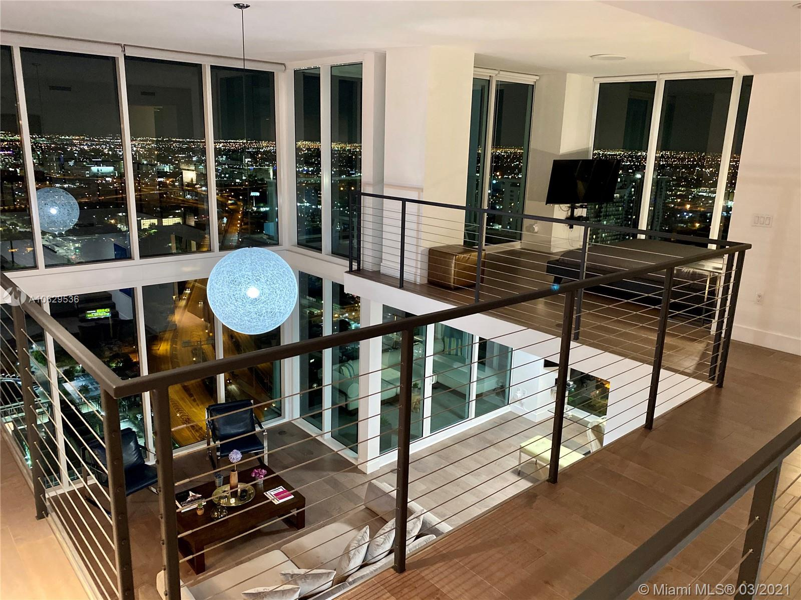 Magnificent 3-story ultra-modern penthouse has two balconies, a PRIVATE POOL with deck and breath-taking city views. Features 2 bedrooms, 2.5 baths, open kitchen, 10ft-20ft ceilings, walk-in closet. Completely redone and furnished, everything is new, including 120-inch projector with screen and foosball table. 2 valet parking spaces. Full service luxury building completed in 2007. Building amenities include gym, spa, sauna and pools. You can walk to Bayfront Park, American Arena, downtown. Truly one of the best penthouses in all of Miami.