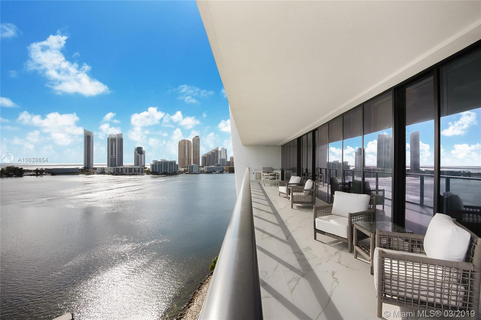 """UNIT DRASTICALLY REDUCED. OWNER NEEDS TO SELL. JUST BRING YOUR TOOTHBRUSH. BEST 4 BEDROOM IN THE BUILDING. SOUGHT AFTER NORTH CORNER UNIT, FINISHED AND FURNISHED BY WORLD RENOWN """"STEVEN G INTERIORS"""". PRIVATE ELEVATOR FOYER.FLOOR TO CEILING WINDOWS IN ALL DIRECTIONS WITH AMAZING VIEWS. AMENITIES INCLUDE PRIVATE GATEHOUSE ENTRY, FULL TIME CONCIERGE, GYM/SPA, MARINA, PIER, 2 POOLS, RESTAURANT, WINE CELLAR, CIGAR ROOM, SOCIAL ROOMS, TEENAGE ROOMS, AND MORE. 4 BEDROOMS AND 5 1/2 BATHROOMS. MAID QUARTERS WITH COMPLETE BATHROOM. SUMMER KITCHEN IN TERRACE."""
