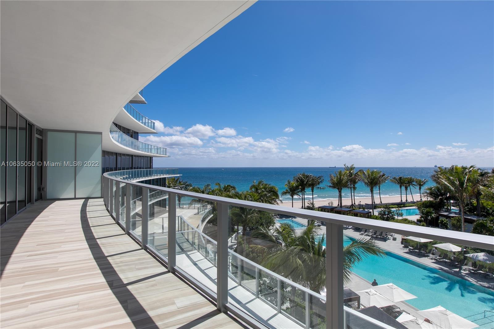 ENJOY PANORAMIC OCEAN VIEWS from this unique & fully turn-key 2 Bedroom   2.5 Bath  exclusive residence with private foyer entrance. Custom design finishes include lighting, porcelain flooring, motorized shades, blackouts in bedrooms,  finished closets, architectural elements, linear diffusers, Italkraft white and espresso cabinetry, Sub Zero and Wolf appliances including Wolf gas stove & coffee/cappuccino maker, Sub-zero wine cooler. This residence has one of the most sought after floor plans maximizing space, privacy and flow. Professionally designed with  Italian furnishings to bestow an elegant and minimalistic style. Perfectly located on 450 Ft. of Atlantic Ocean beachfront.
