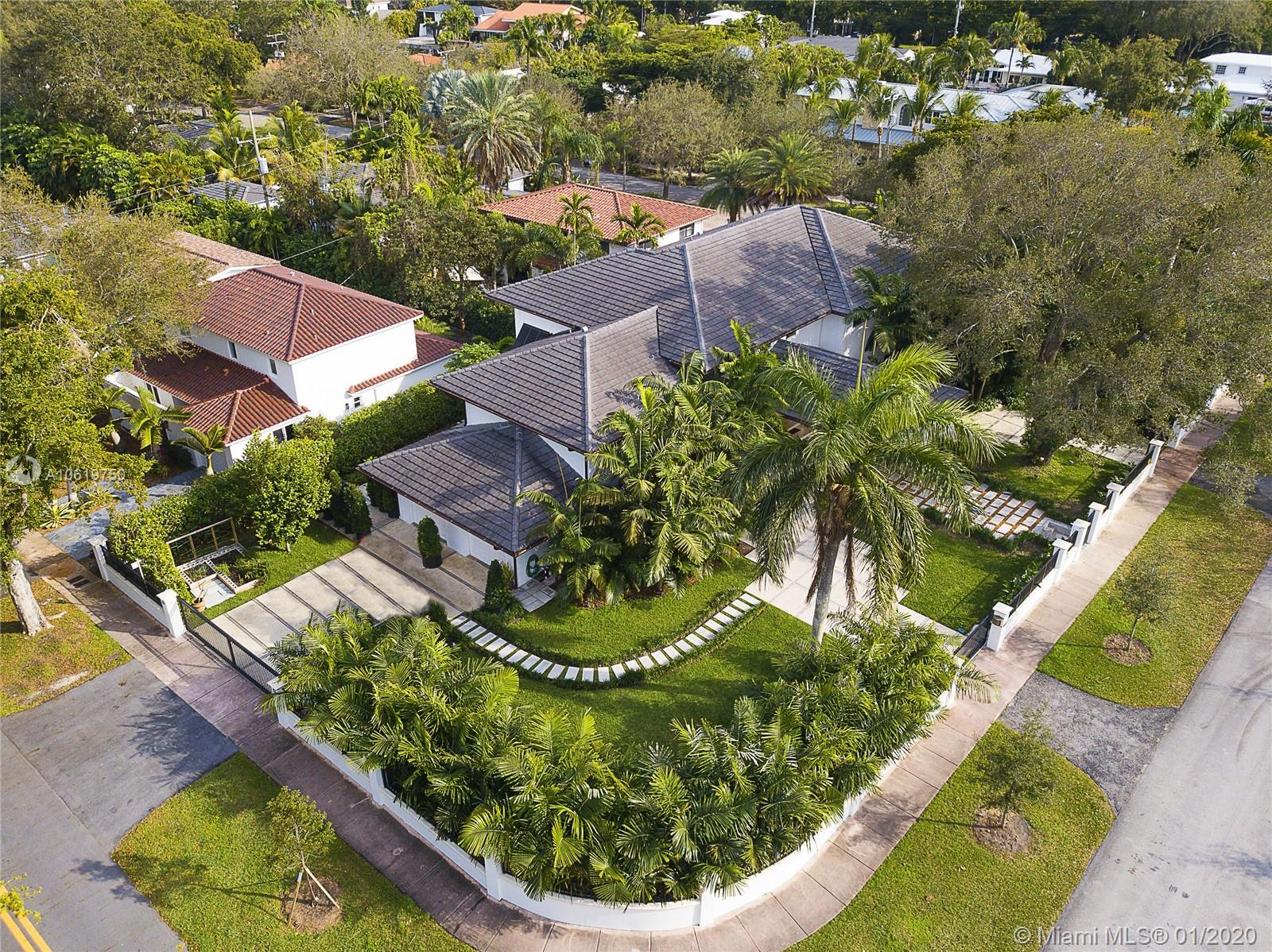 Amid the soaring ceilings, large art walls and beautifully proportioned spaces, this totally renovated 5 bedroom home awaits one of your most discriminating buyers. Sited on a 21,000 s.f. lot in the heart of Coral Gables, this beautiful property is convenient not only to MIA, but also to the Shops of Merrick Park, Dadeland and downtown business district.  With amenities that include a beautiful kitchen with top of the line appliances, pool and adjacent summer kitchen, numerous sitting areas, and stunning garden views from almost any point in the house, this property is an invitation to gracious living and entertaining.