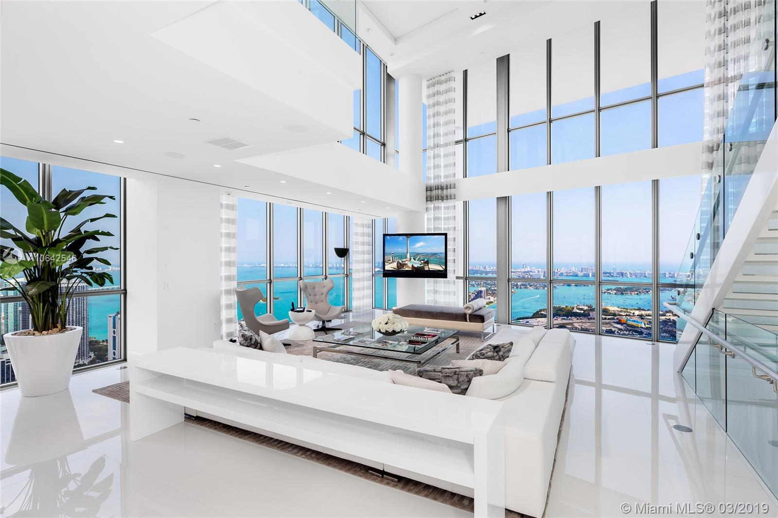 Located at the Marquis in the heart of downtown Miami this 4-Story Penthouse is the pinnacle of luxury living. No expense spared in the 8,000+SF residence. Open flowing living, dining & family areas, illuminated stairs, interior elevator, white glass tile floors, soaring ceilings, approx. 2,000 SF terrace with a private rooftop pool on 67th floor overlooks the city. Breathtaking unobstructed views as far as the eye can see to Biscayne Bay, Atlantic Ocean, Miami Beach & Downtown Miami – must see to believe. The entire 3rd level is the principal suite w/bar, voluminous dual walk-in closet, fireplace & amazing spa bath-all w/stunning views. Centrally located, minutes to sports & cultural venues, entertainment, dining & shopping. 5-star Marquis Amenities complete this offering.