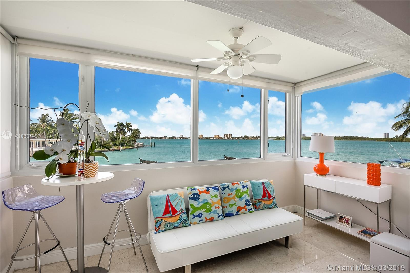 Turnkey unit completely furnished with modern white quality furniture almost new and not being used. Seller has relocated overseas and needs to sell. Fabulous wide bay view from this corner unit with million $ homes at your feet across the canal while overlooking the wide bay and the yachts cruising on the Intracoastal. Feels like living on a boat. Completely remodeled including impact windows. Gorgeous state of the art kitchen with top of the line stainless steel appliances. Marble floors throughout. The large pool is located right next to the dock at the end of the canal with the most beautiful view of the bay. West exposure with incredible sunsets . This is a co-op. Cash only. No rental allowed. No pets. Walk to the beach and the world famous luxury Bal Harbor shops!   Stunning unit.