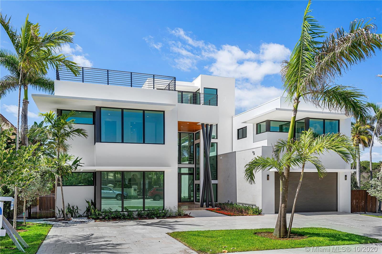 """Spectacular New Construction 5 bed/5 bath pool home in a very desirable location just a short block from the beach. This home was built to the highest standards with impeccable finishes. The patios and terraces have southern exposure, which takes advantage of the winter sun. The third floor has views of the ocean and the park. It is an ideal spot to """"chill"""" and expand the entertainment areas of the home. Naturally, the home has an elevator. The first floor has a large bedroom which could be used for a mother-in-law , maid or quest quarters. The large 1/4 acre + lot adjacent is also available, this lot backs up to the park with access to the lake """"lagoon""""."""