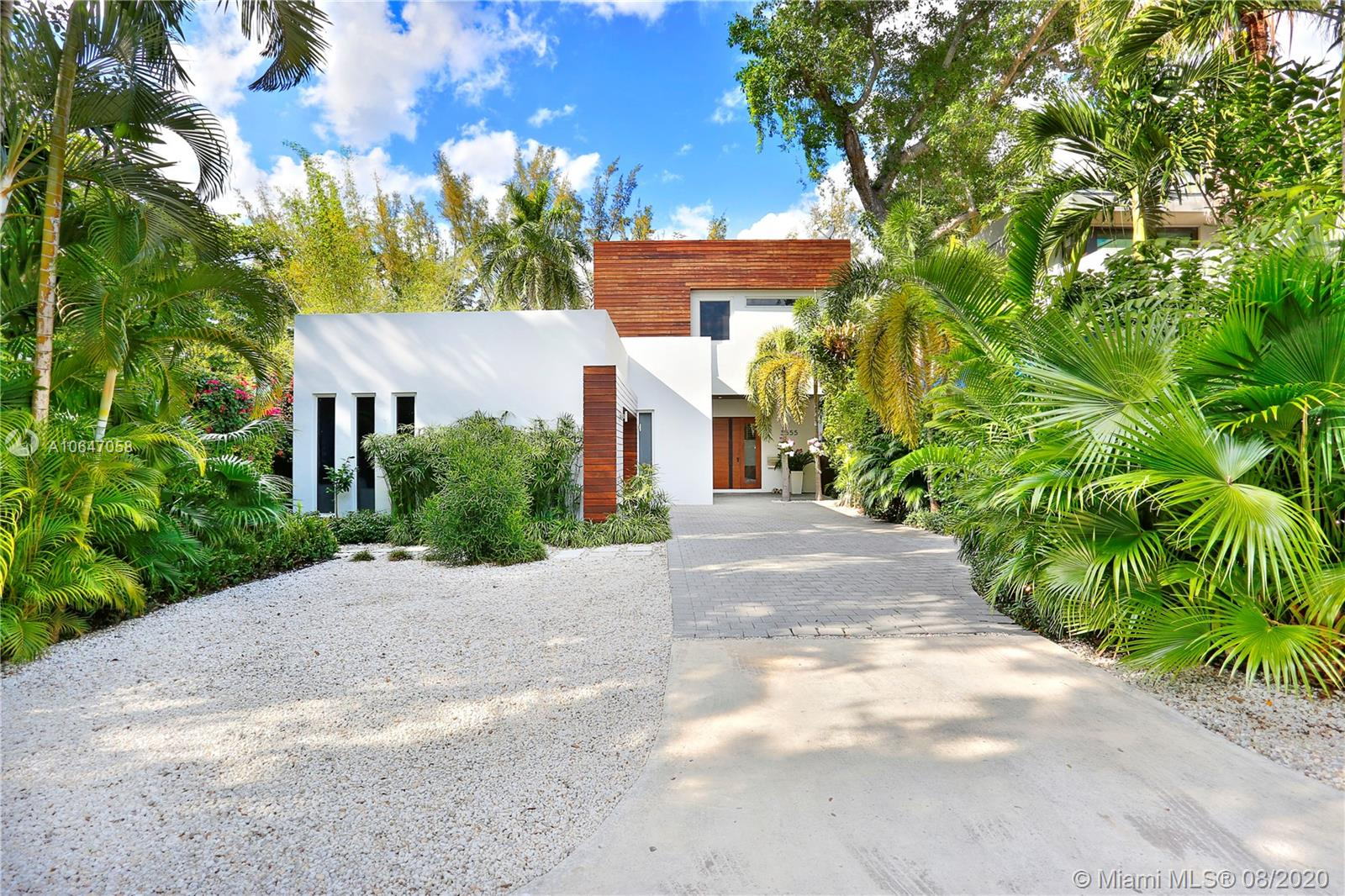 Spectacular Tropical Modern home on a quiet South Grove street. Walls of glass & soaring ceilings create light-filled open living spaces overlooking serene pool & terrace. Formal living & dining spaces & European style kitchen that features quartz countertops, high-end appliances & island. 4 BR's with en-suite baths plus upstairs den, easily converted to a 5th BR. Large master suite includes spa-like bath & private balcony w/ tree-top views. Deep lot runs street-to-street, creating an ultra-private back garden w/ lush landscaping surrounding the outdoor living/play area. Walk to some of South Florida's best schools: Ransom Everglades, Carrollton, St. Stephen's & more. Close to the Grove village centers boutiques, cafes and bay front parks & marinas. Minutes to downtown, MIA & the Beaches.