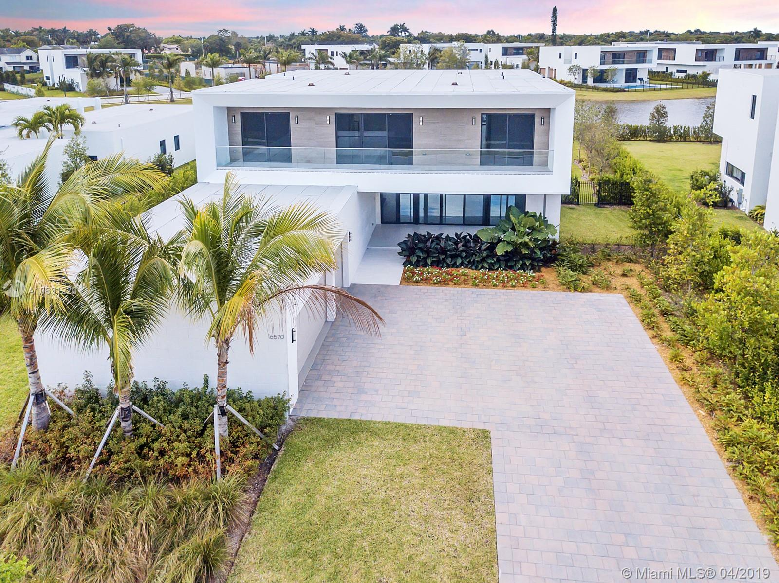 Brand NEW SUPERB UPGRADED Luxury home ready to move in with 5 spacious bedrooms plus maid quarters, 6 1/2 bathrooms, 3 car garage and a huge parking driveway modern gem designed by Chad Oppenheim. Sitting on a SUPERB 20,756 SF lot that was carefully chosen by owners is considered the best one at Botaniko because it has water views from every single room, The amazing kitchen includes an integrated SubZero wide refrigerator and freezer and a Bosch built-in automatic coffee maker, also a wet bar Cooler. Weston is ranked #8 of the best places to live in America enjoy it than having a covered patio with an amazing summer kitchen this swimming pool has special requires distance between the house and the pool much more than any back yard paver floor Splash, LOOK NO FURTHER!!! Paradise on earth...