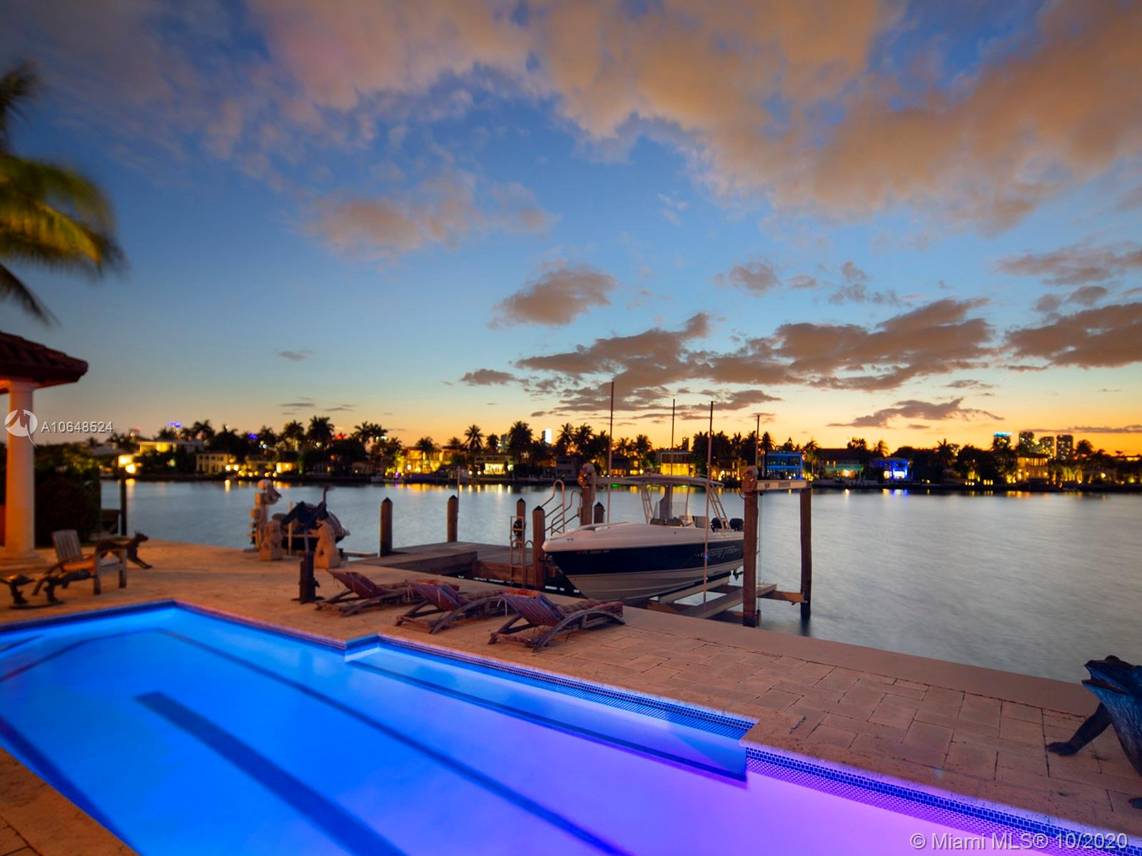 Stunning North Westerly sunset views from this beautiful Mediterranean waterfront home on the highly sought after north tip on Venetian Islands. Built in 2001 this five bedrooms and five bath home with soaring double height ceilings upon entrance, office with wood panel cabinetry, spacious master suite on second floor with wide bay water views and balcony. Located on the closest Venetian Island to Miami Beach, Rivo Alto Island, this 13,382 sqft pie shape lot with 106 ft of waterfrontage has power lines underground, sidewalks, short walking distance to Lincoln Road and Sunset Harbor retail. Private dock with lift, inground tiled lap pool, and 3.5 car garage, elevator, impact doors and windows, generator, secure gated entry, electronic shutters. Easy to show so call today to schedule a tour!
