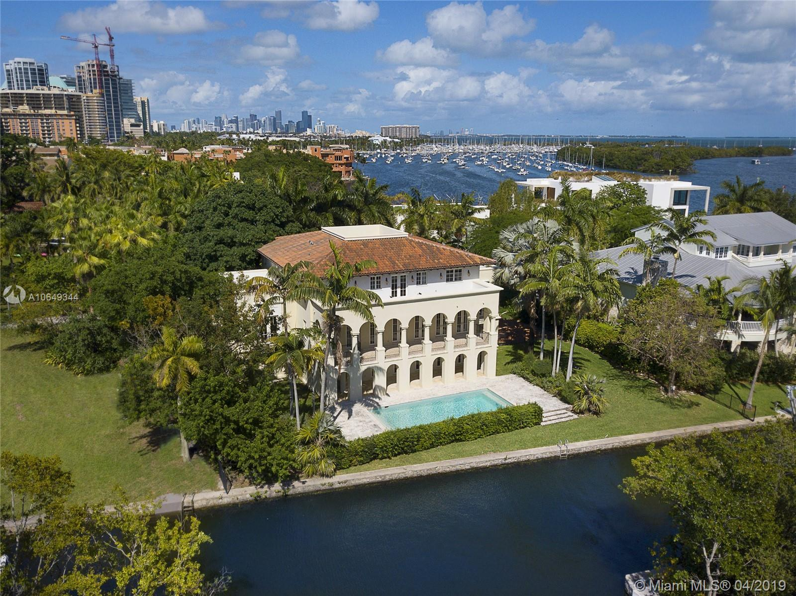 Ideally situated in the heart of the Grove behind gates of exclusive Camp Biscayne, this 2003 built home boasts 122' of water frontage & breathtaking views of the Bay, canal & natural landscape.  The elegant style offers sophistication w/ details like mahogany trimmed impact glass drs & wndws, Brazilian wd & Jerusalem marble flrs, arches & vaulted ceilings. Formal spaces incl gracious dining rm & huge liv rm that flows out to a balcony spanning the back of the home. Cook's kitchen offers gas, high end appliances & breakfast rm overlooking the canal. Outside are many covered balconies & open porches, including a roof top terrace & heated, saline pool w/ keystone flrs & views of the boat basin at La Brisa. 1st floor ac'd bonus space w/ full bath, 2 car gar, organic mosquito repellant system.