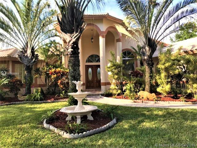 "Beautiful 5 bedrooms, 3.5 bathroom home situated on corner lot and partially surrounded by lake in gated community in Parkland. Large gourmet kitchen with six foot columns, granite counter tops, double ovens, stainless steel kitchen aid appliances and large cooking island. Home has been totally remodeled with marble and real hard wood cherry floors. Roof has been replaced in 2007. Large master bedroom with sitting area. His and her closets. Huge master bathroom with his and her vanities, Jacuzzi tub, walk in showers with rain heads and bidet. High ceilings with breath taking view of pool overlooking the lake and tropical fruit trees. Within walking distance from the home are tennis courts and ample guest parking. Close to shopping, parks and Parkland's ""A"" rated schools."