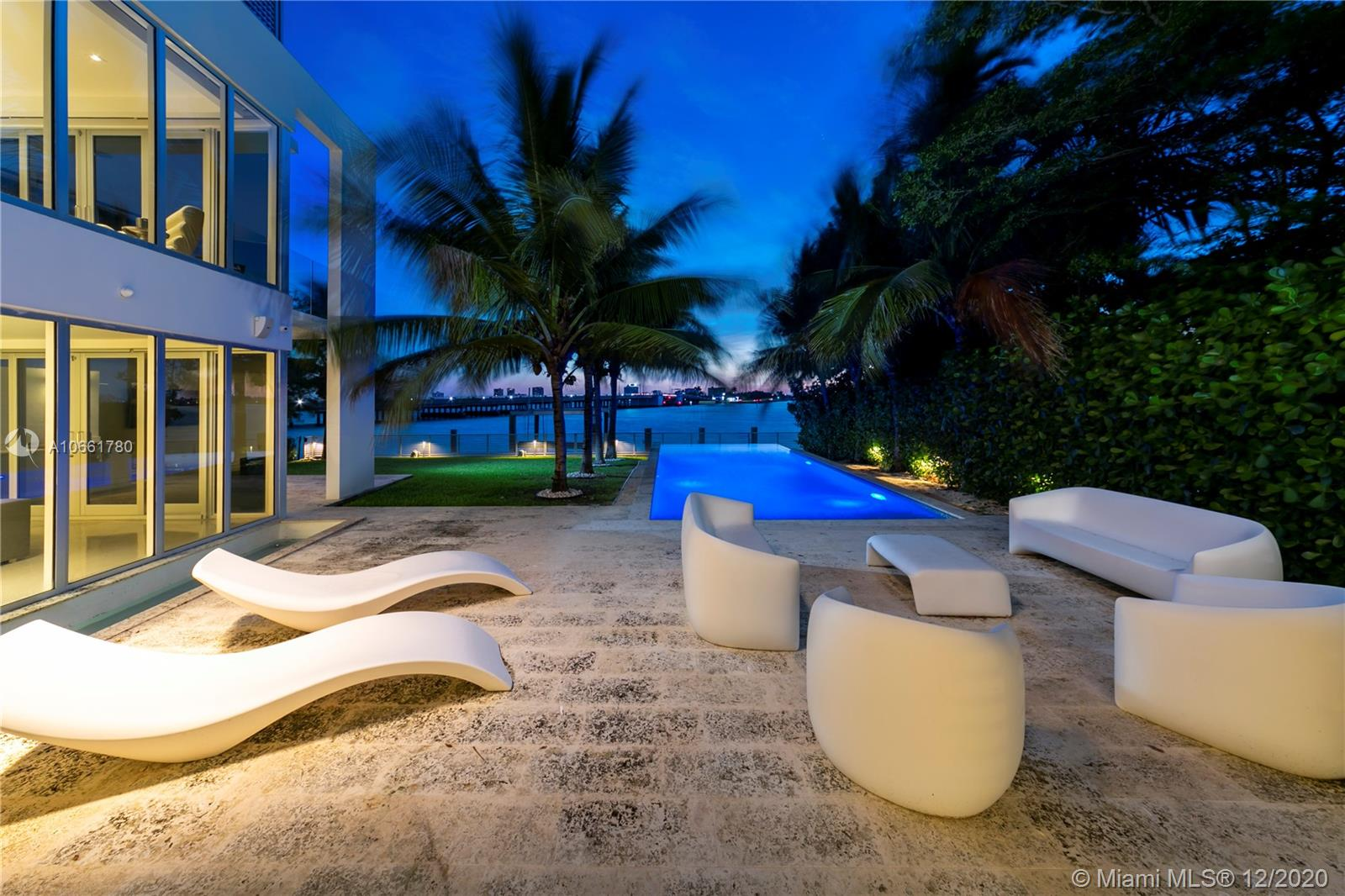 This stunning new construction (2014) masterpiece was conceptualized and brought to life by world-renowned architect Luis Revuelta and is nestled on the coveted west side of Bay Harbour Islands. Boasting wide bay views from multiple rooms in the house, 9710 West Broadview was built as a modern day fortress - sitting 13' above sea level. Some of the features of the home are 18 ft. ceilings in the great room, a huge waterfront rooftop terrace with a bar, a Lutron smart home throughout the residence, a salt water infinity pool, a summer kitchen, a backup gas generator, a two-car garage with high ceilings for storage, and much more...