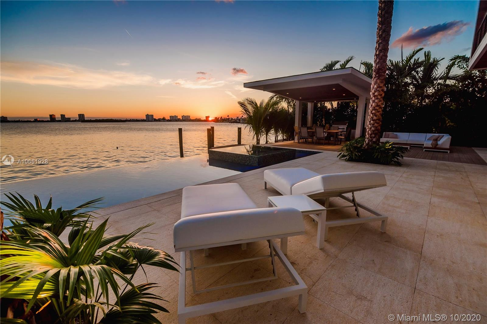 Dream waterfront mansion offering incredible water views, endless sunsets, and views of Indian Creek Island! The perfect balance of oversized glass with exposed concrete creates a striking contemporary appeal, while the interiors are warmed with different tones of wood finishes. The oversized living areas are introduced with a large foyer room leading to an interior garden, a formal dining, and a waterfront living room with an open kitchen plus a chef's kitchen concealed with frameless doors! Huge upper family room, sauna, & a master taking the entire waterfront side of the home. Exceptional outdoors, infinity pool, spa, summer kitchen, 2-car garage, rooftop ready! Minutes away to Bal Harbour shops! Created by the vision & dedication to perfection of Gamma Construction & CBDesign Team.