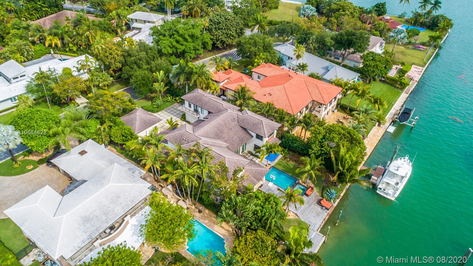 """You will not find a better waterfront Home/Community anywhere near this price. This 2011 custom built home is located in one of the safest and most exclusive gated neighborhoods in Miami. The 5 Bedroom 6 Bath 5,579 Interior Sq. Ft. Home is a modern tropical paradise. Magnificent entrance with floor to ceiling windows gives an abundant amount of natural light overlooking the pool and water. Property has 85 Ft. of water frontage and located only 5 lots from the open bay with no bridges exclusively located on the """"island"""" section of Bay Point which brings tremendous value in the community. Floor plan is perfect! Large bedrooms, split plan and very defined and open spaces perfect for a family that enjoys indoor and outdoor entertaining. Home is priced to sell and will not last."""