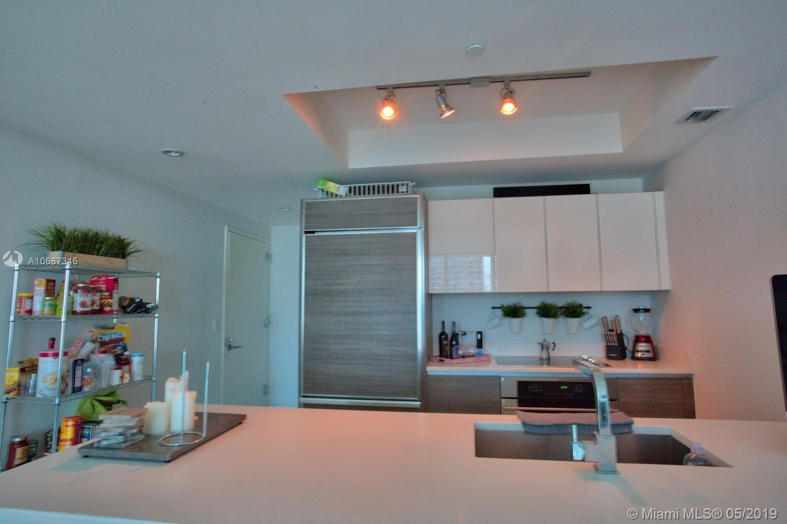 Stylish 2 bedrooms, 2 bath unit, porcelain floors throughout, Italian cabinets, integrating the refrigerator and dishwasher, creating a balanced seamless look, in exciting and electrifying Brickell.