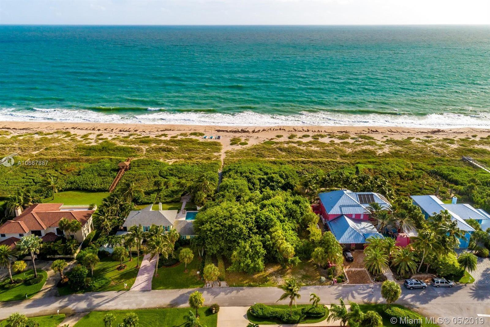 """Spectacular Atlantic Oceanfront Lush Vacant Lot located in the sought after private gated community of """"The Dunes.""""  This rare opportunity homesite is located amongst multi-million dollar properties on one of Vero Beach's best beach areas of South Beach.  A magnificent property that sets the stage for the perfect dream home where panoramic ocean views can be enjoyed by everyone.  Located near shopping, restaurants, schools, supermarkets, houses of worship, gallery's and much more!!!"""