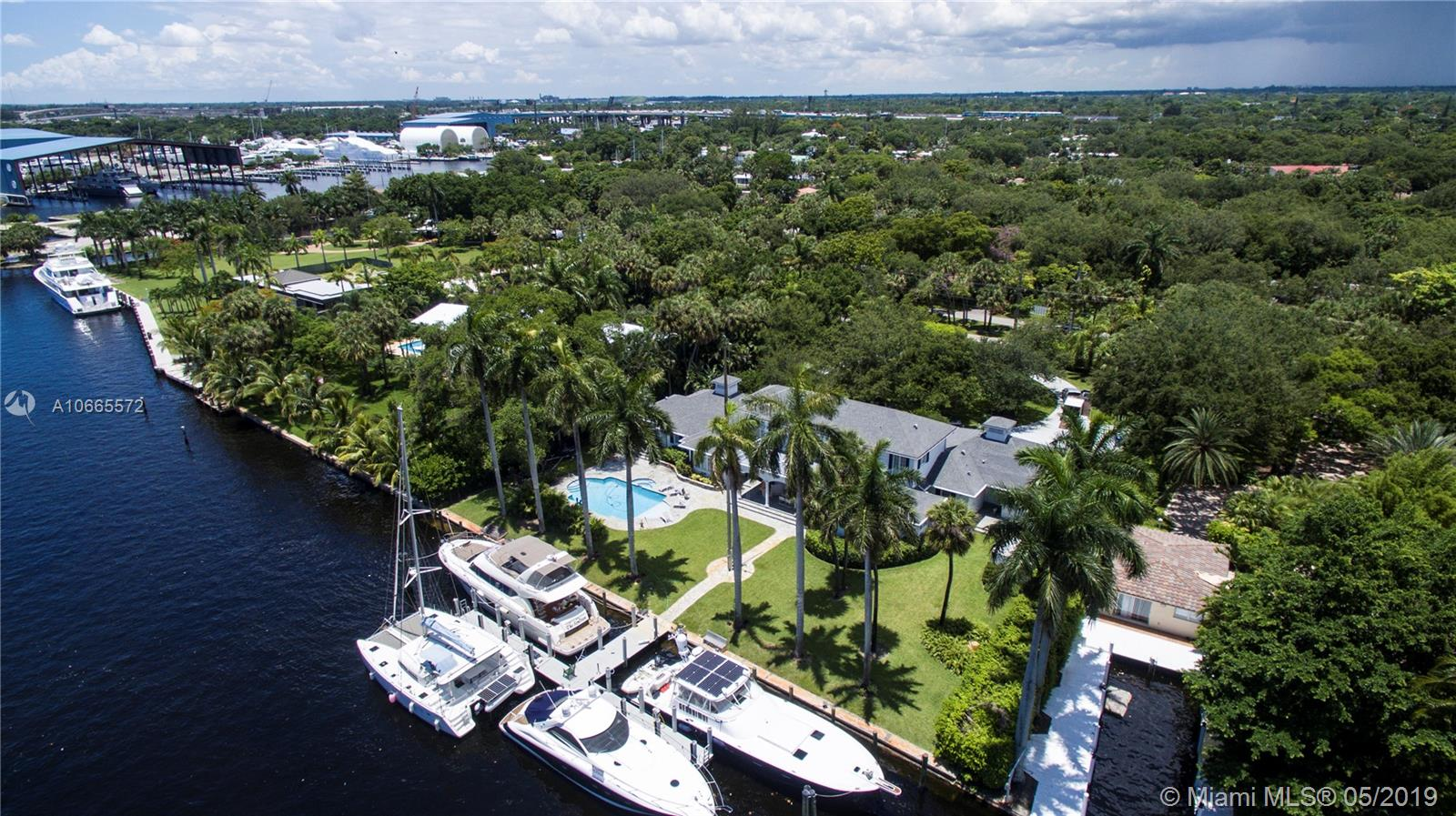 BREATHTAKING LUXURY RIVERFRONT HUGE ESTATE WITH PRIVATE MARINA HOSTING MULTIPLE BOATS AND DIRECT OCEAN ACCESS. BOATER'S DREAM !! Sophisticated interior that features 5 bedrooms, master suite, dressing rooms, all dressed with cherry wood and carpeted floors as well as a beautiful gourmet kitchen. Great location (minutes to downtown, airport and beaches). The private docks can host up to 4 Yachts and be rented separately for up to $4,000/month. 300K PRICE REDUCTION !!